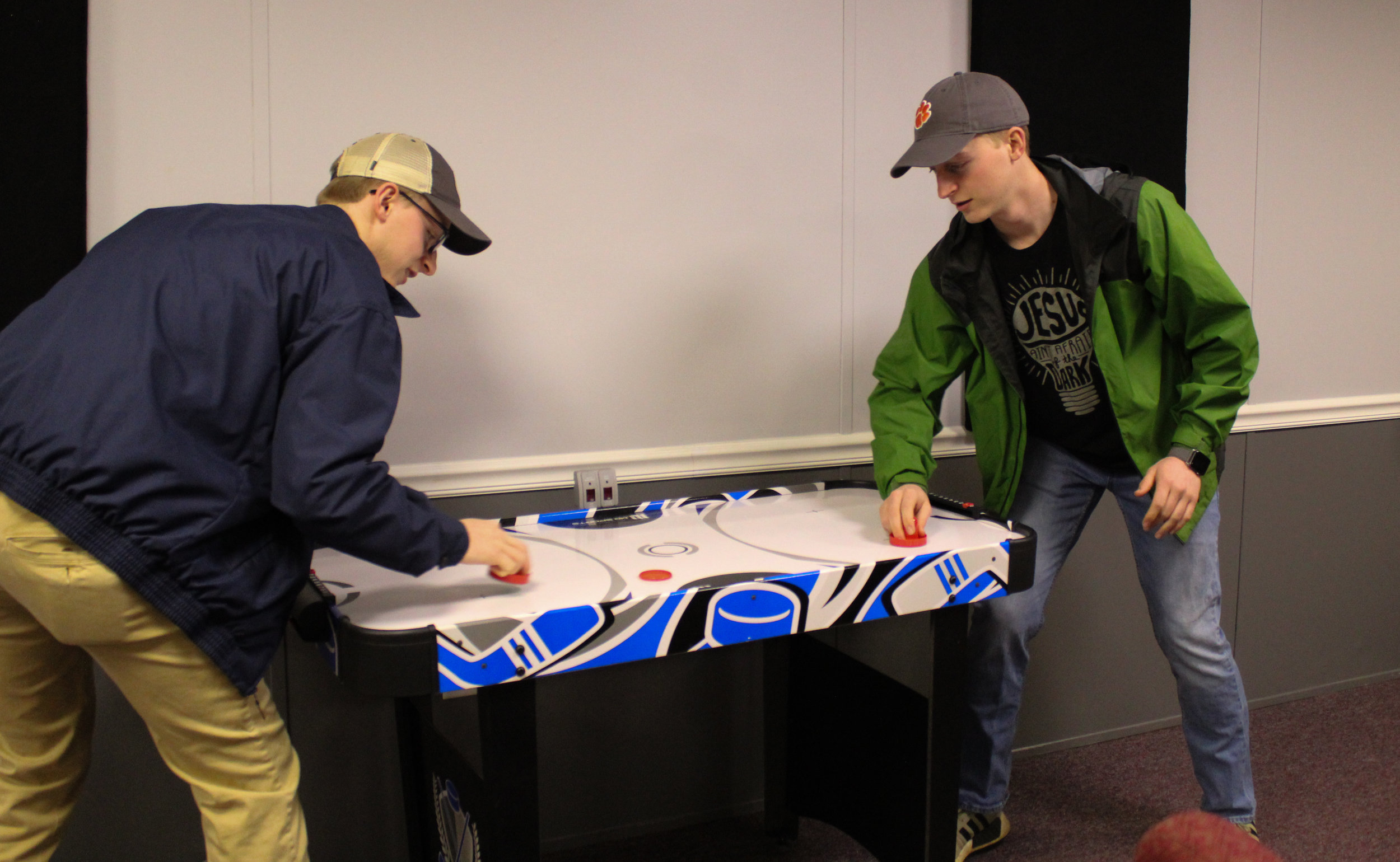 Youth leaders Will and Nathan Ingle brawl in a game of air hockey.