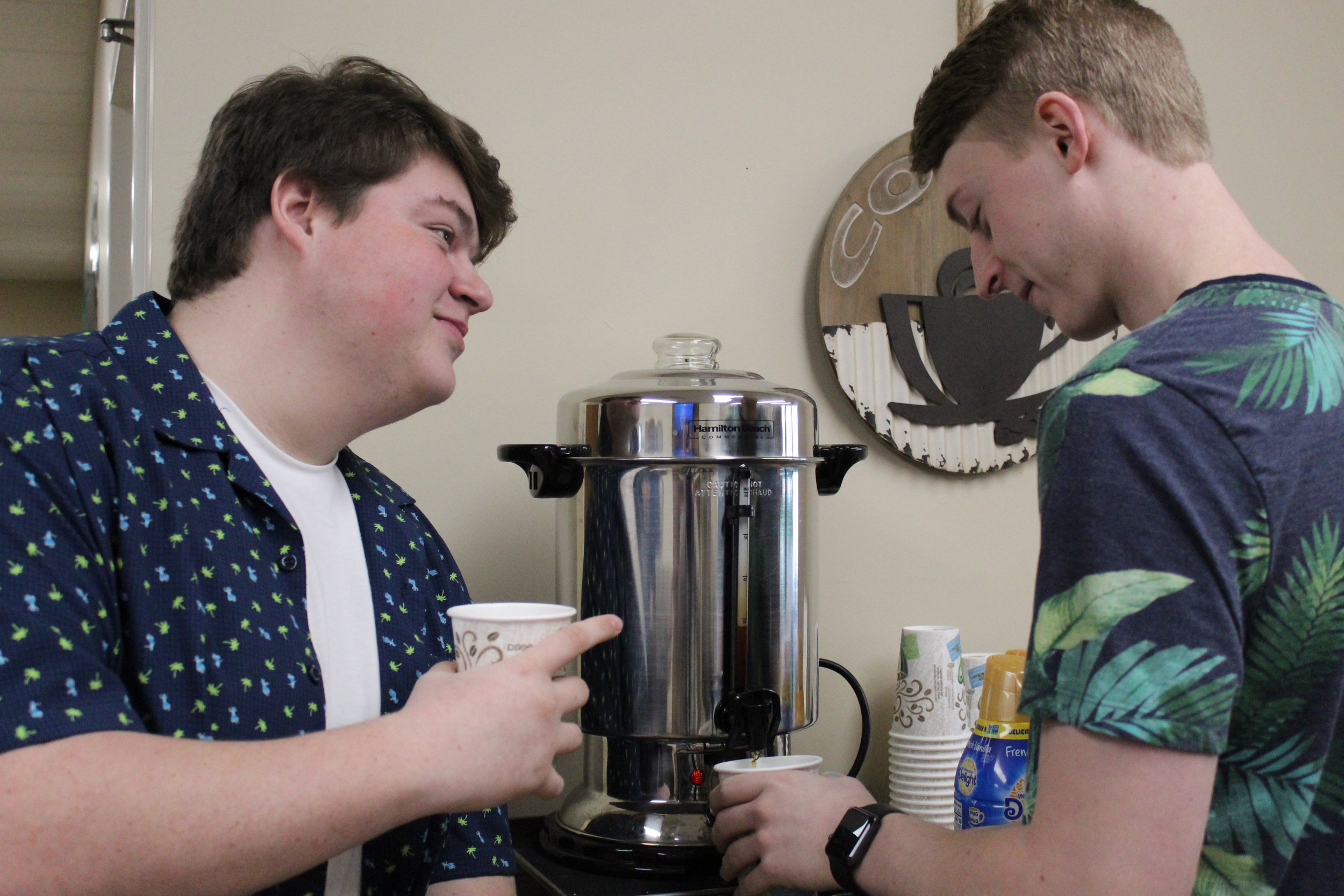 Pictured here is Jameson Evatt and Nathan Ingle fellowshipping over a cup of coffee before Sunday morning service.