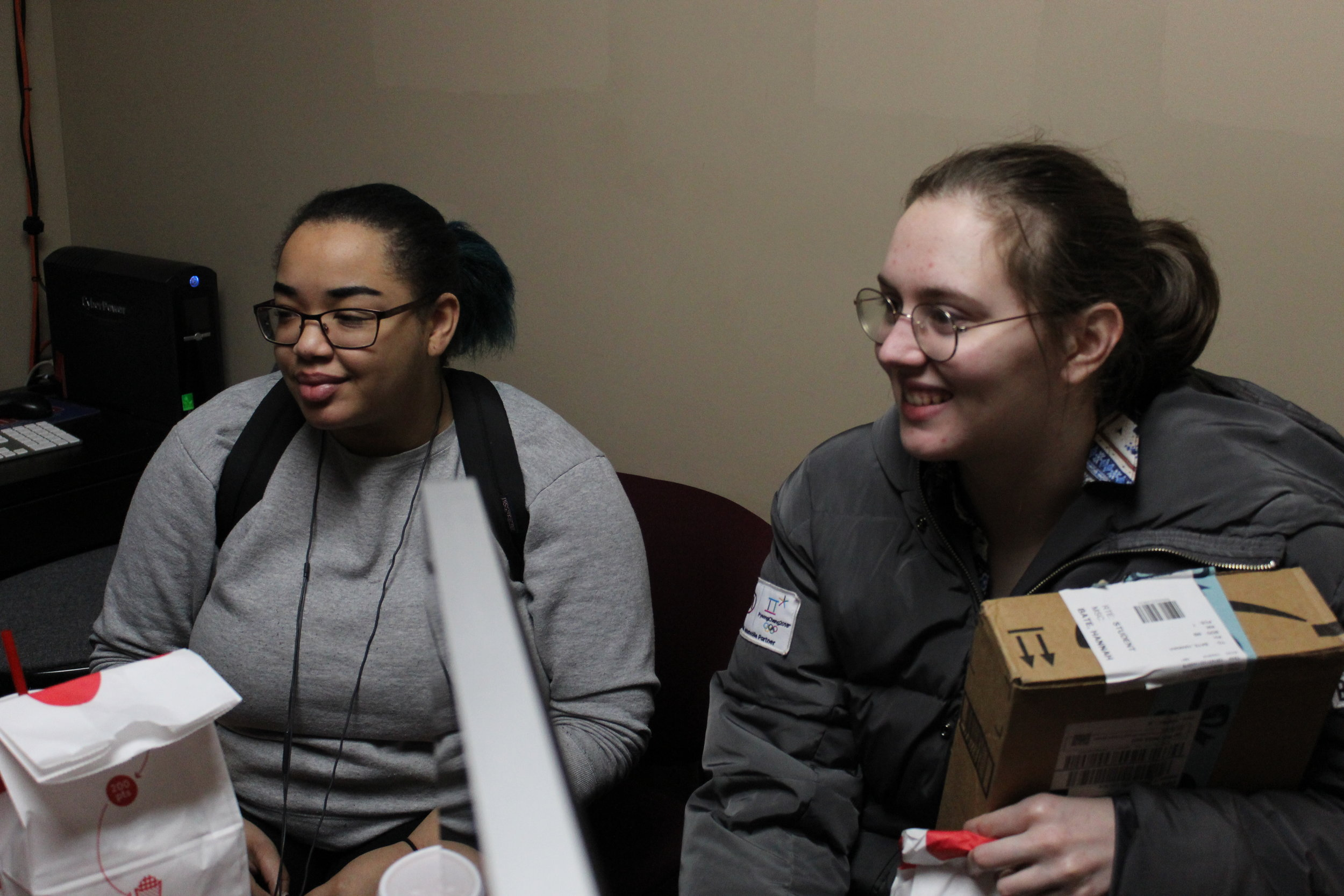 During downtime, students Ashia Davenport and Hannah Bate have a conversation with Professor Gopal.