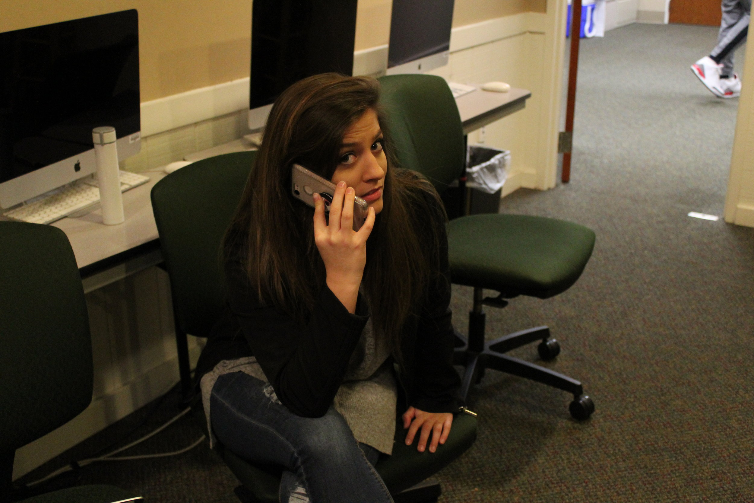 Sophomore, Vivian Wortkoetter, is caught on the phone talking to her friend.