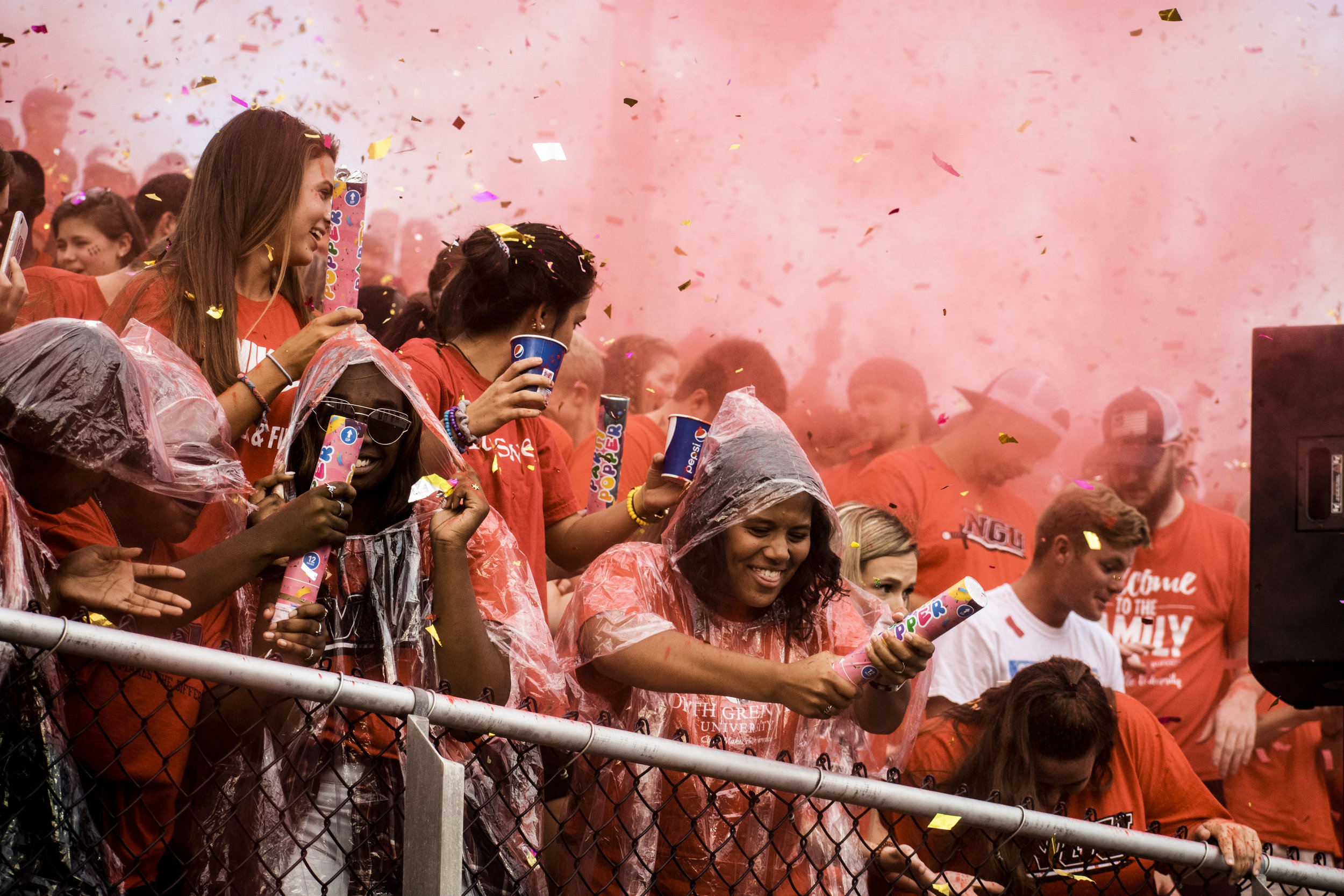 The student section gets crazy after bags of paint and confetti have been thrown.