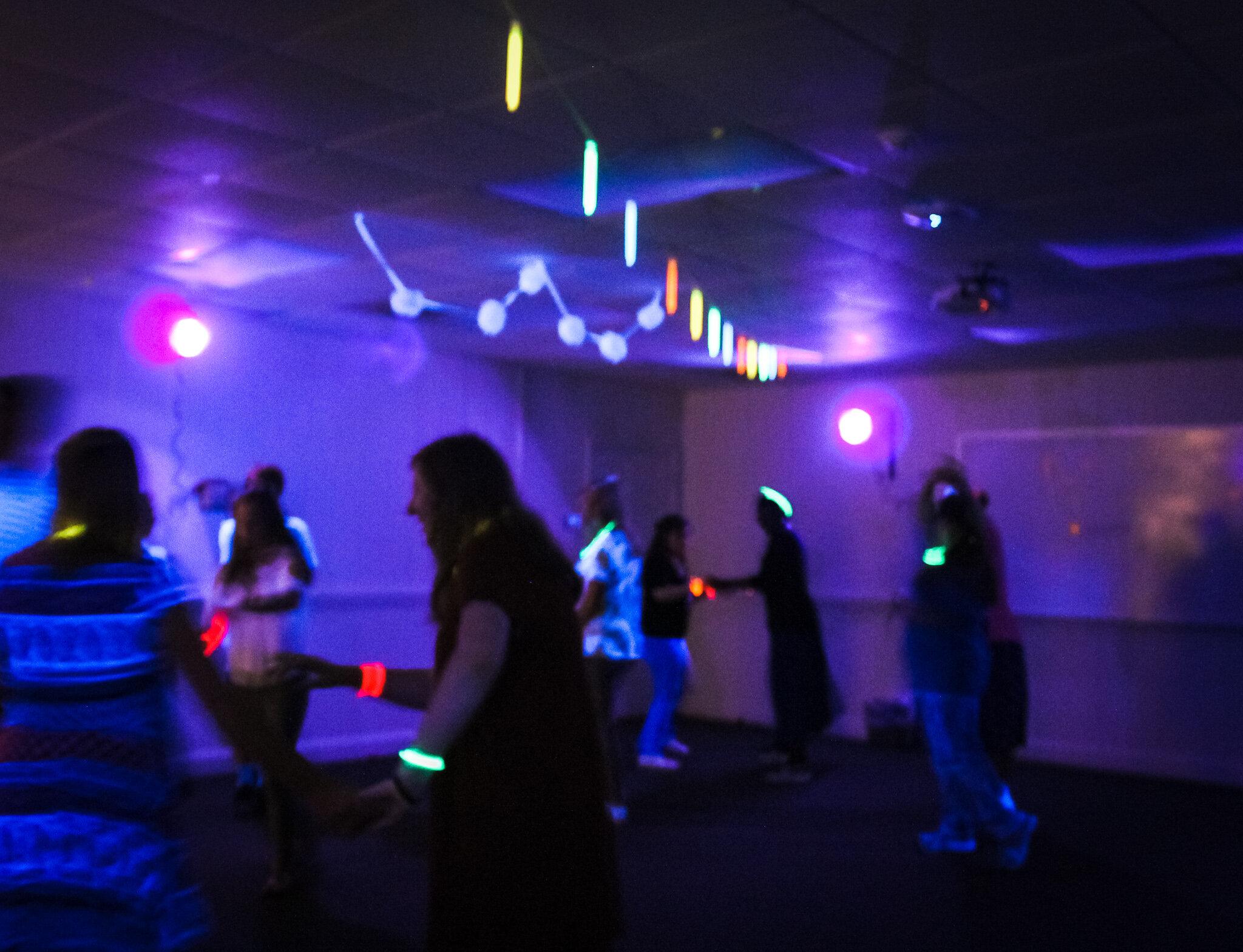 Swing dance club members dancing at the glow party.