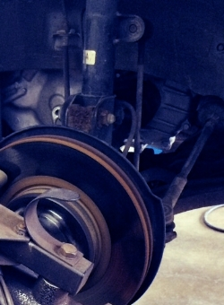 Brake lathe resurfacing rotor while on vehicle gives truer surface for longer brake life.