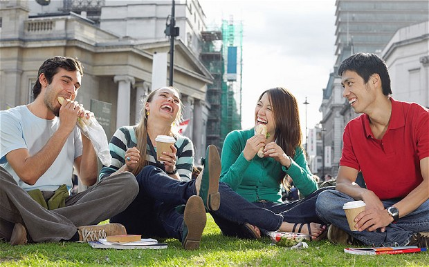 happy young people in a city picnic