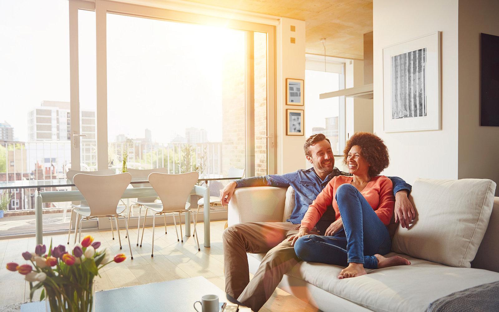 happy couple in apartment