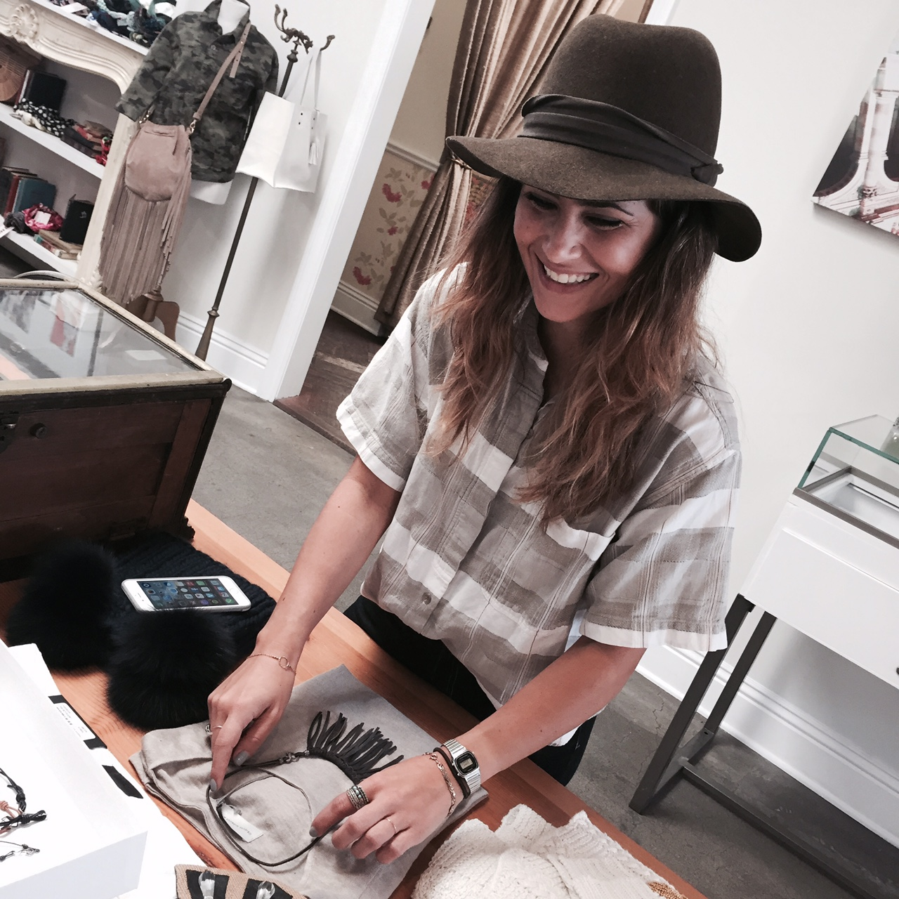 """Store Manager, Whitney, is all smiles about our newest """"Diamonds on the Fringe"""" necklace."""