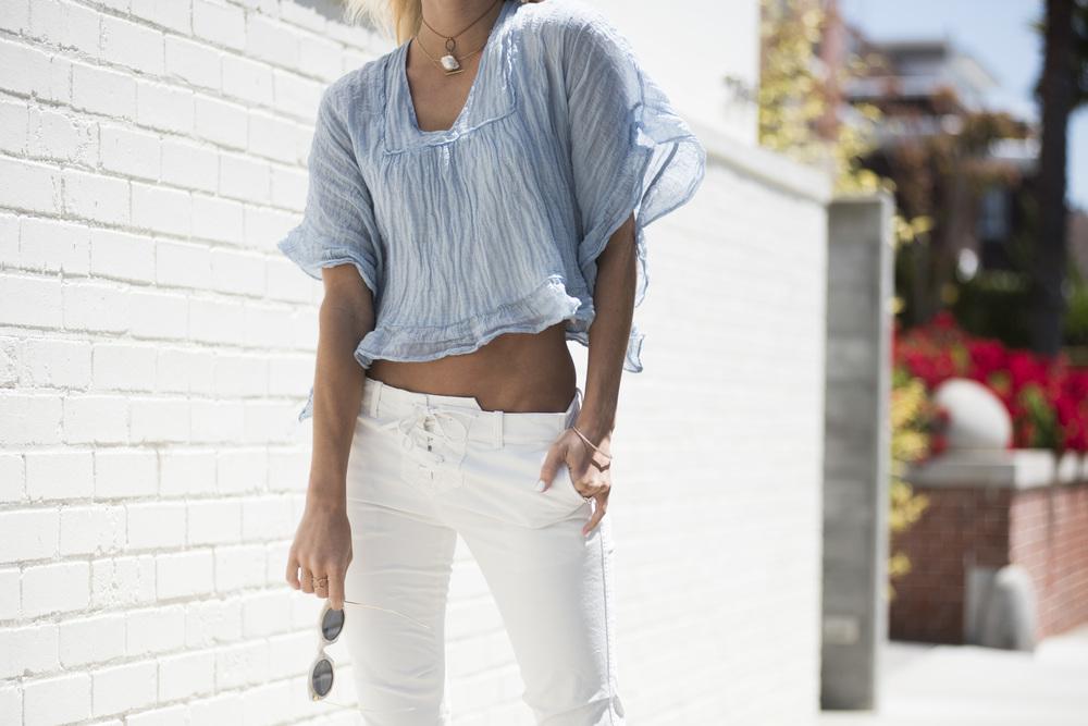 Top: Chloé Diamond/pearl choker: Designs by Alina Sunnies: Illesteva Pants: Nili Lotan