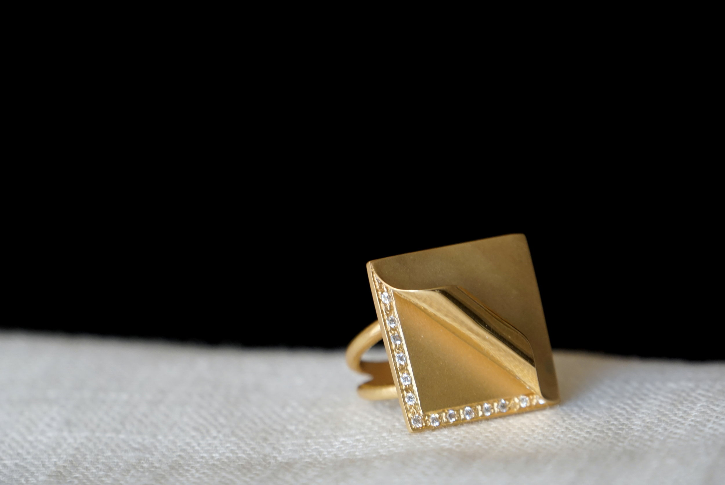Uncovered,  hand-forged in 18K solid gold with white diamonds.
