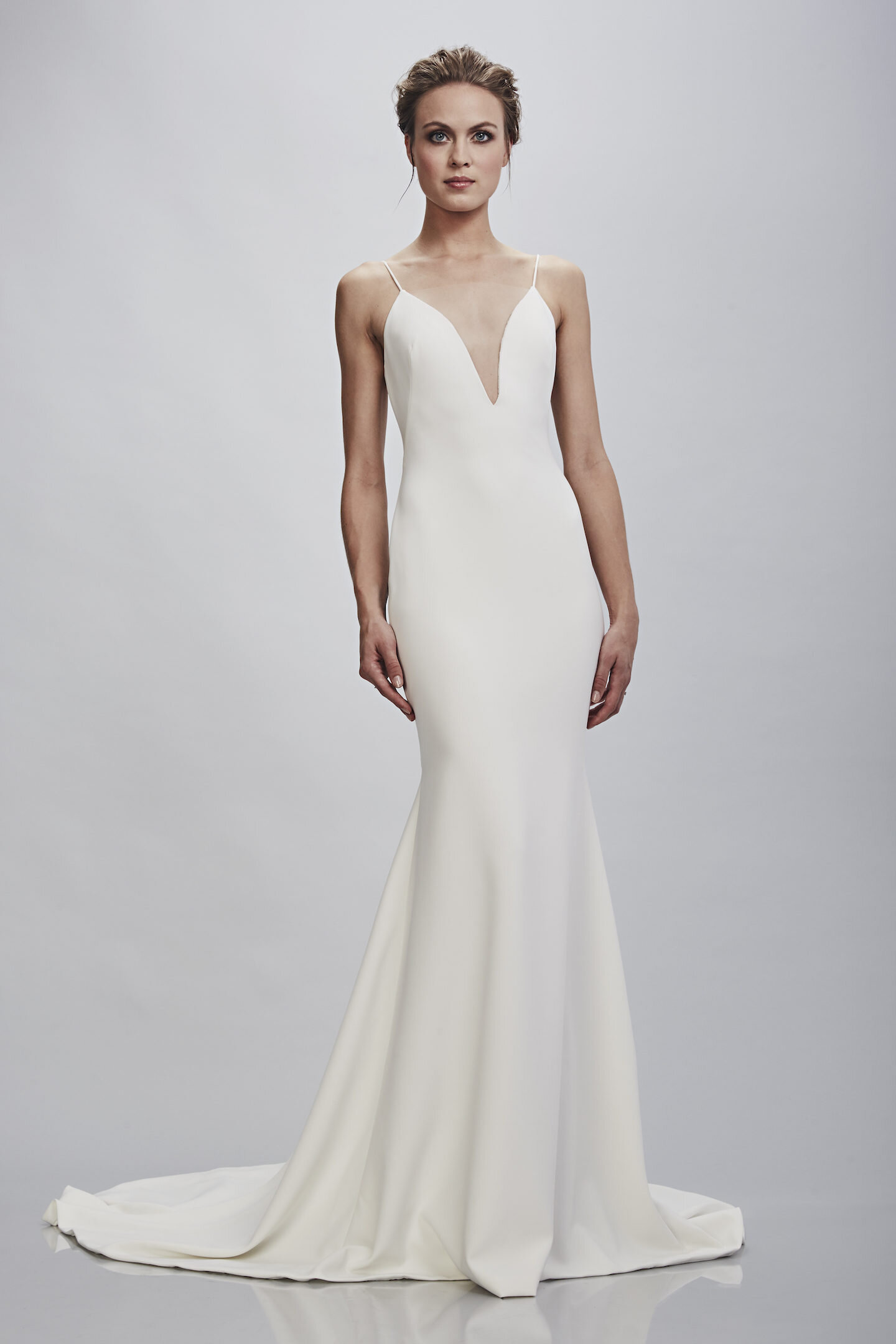 Theia - The Theia bride wants a gown that is unique, but yet still feels bridal. Known for their embellished couture beading and and attention to detail, each gown is meticulously constructed offering flattering fits and impeccable quality. Modern and elegant, these gowns are made to bring out your inner goddess. Collection begins at $1,295.