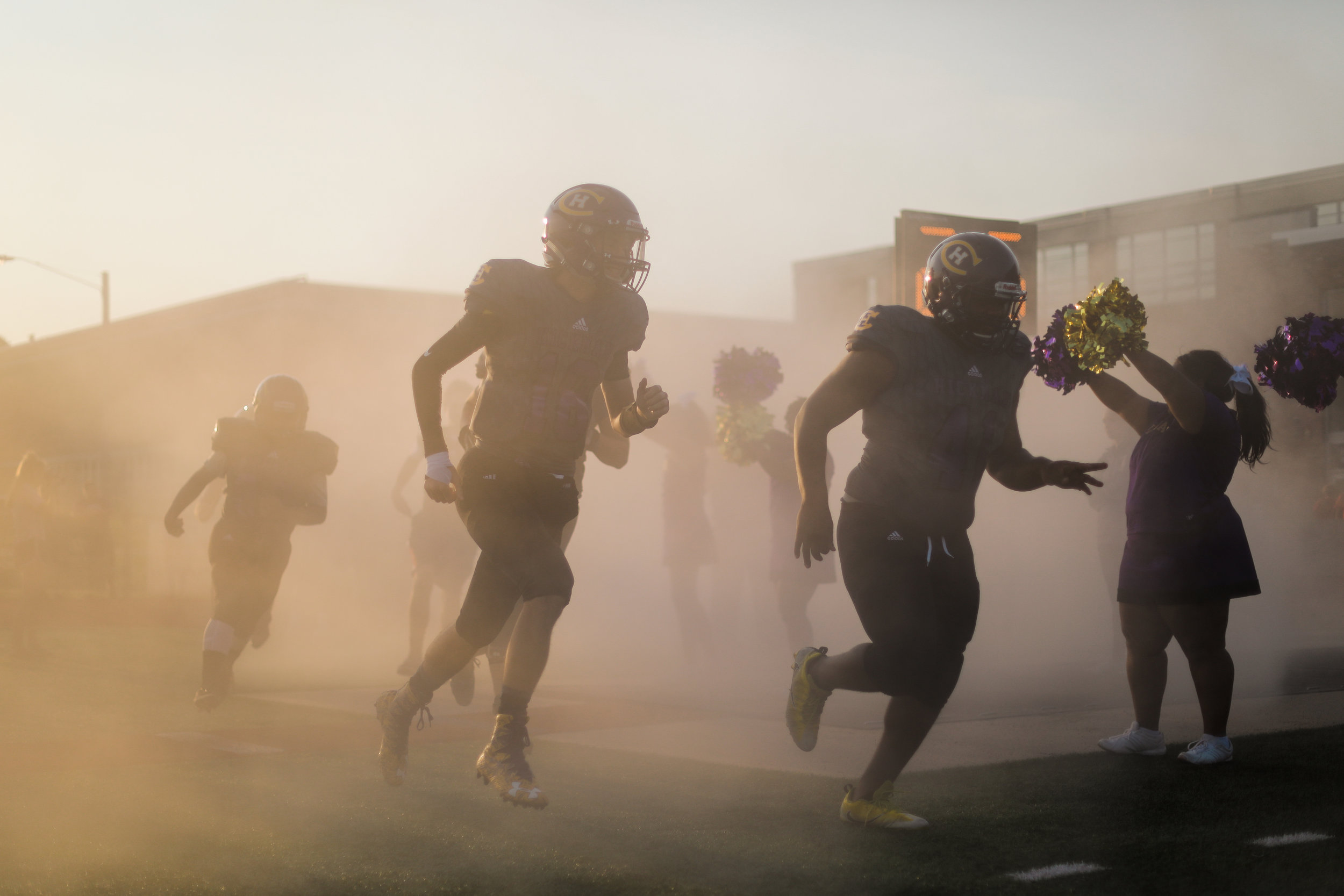 Hickman High School football players run through a cloud of smoke before the game against Jefferson City High School on Friday, Sept. 1, 2017, at Hickman in Columbia, MO. Hickman lost 28-9.