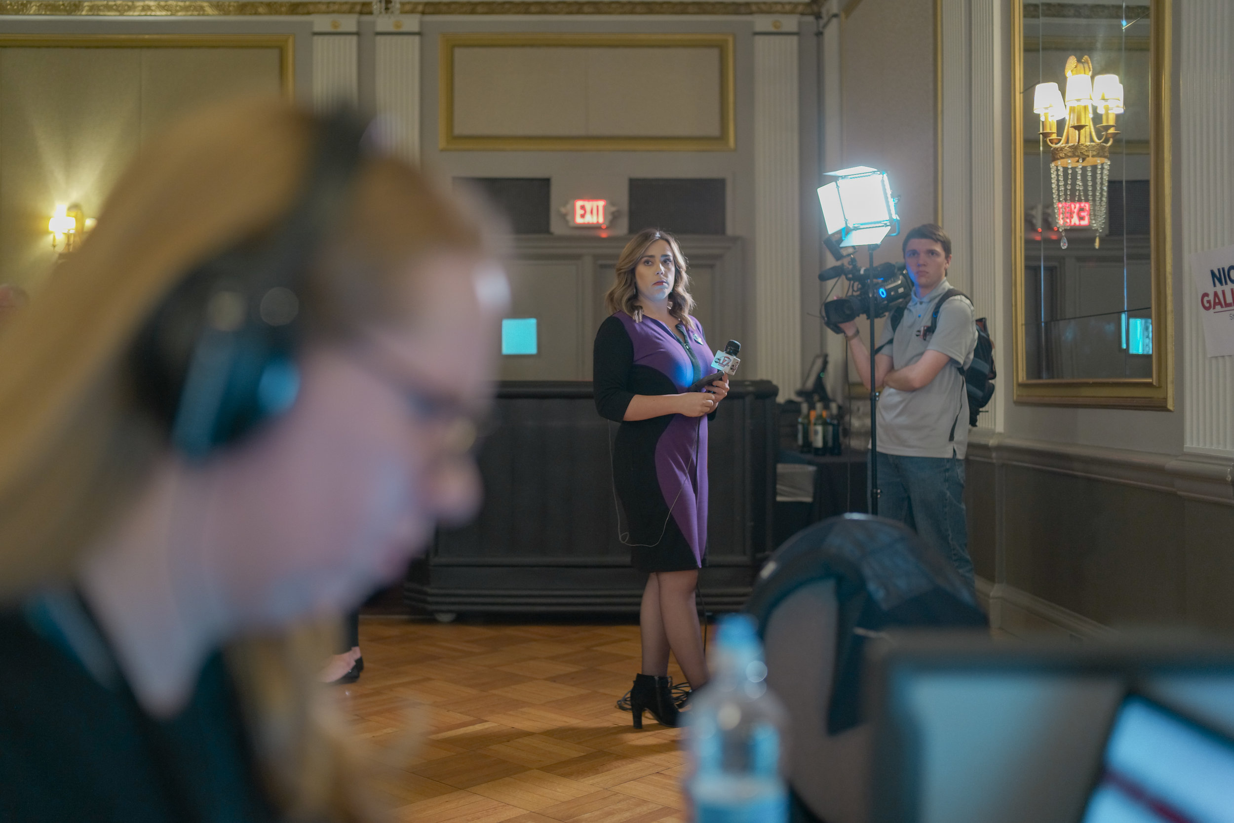 """As Aviva Okeson-Haberman, KBIA reporter, updates her story as ABC17 KMIZ's Sara Maslar-Donar goes live on the 9 o'clock news on Tuesday, Nov. 6, 2018 in The Tiger Hotel. """"I'm not the fastest writer, but it will get done,"""" Okeson-Haberman said."""