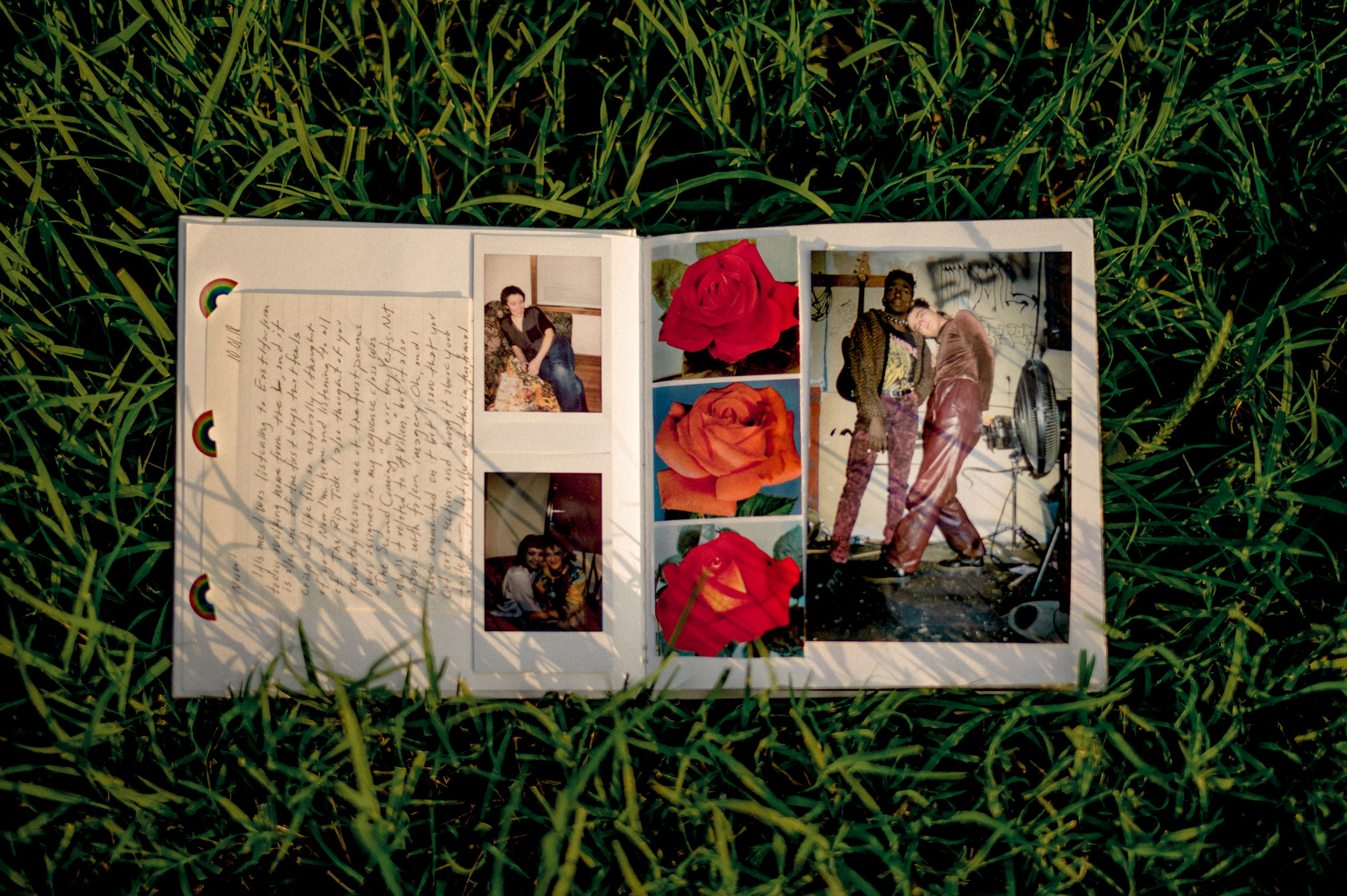 A hand-made scrapbook rests on the grass near Noah Doolady's home in Columbia, MO.