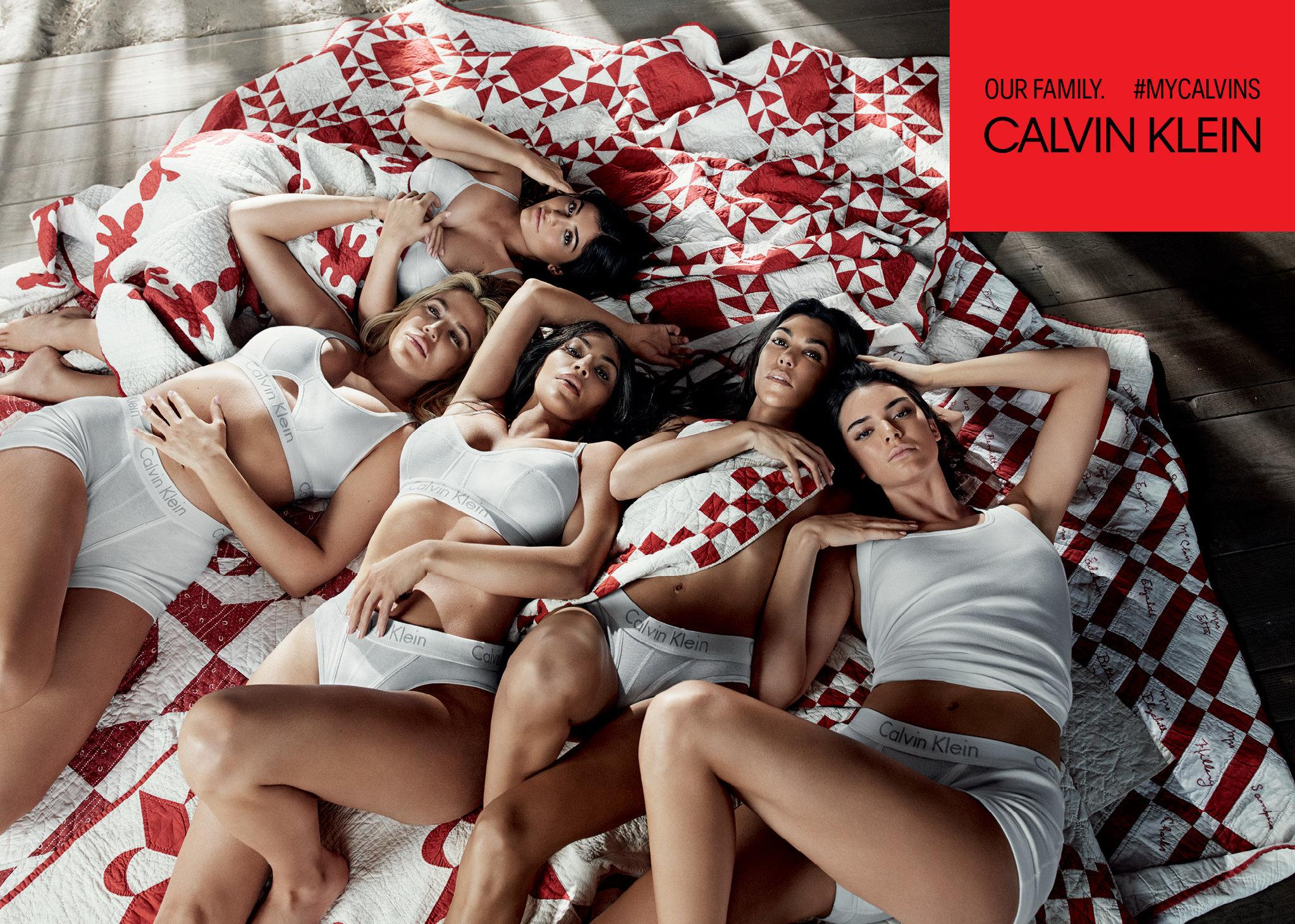An advertisement featuring the Kardashian-Jenner sisters on a quilt. Credit: Willy Vanderperre, via Calvin Klein