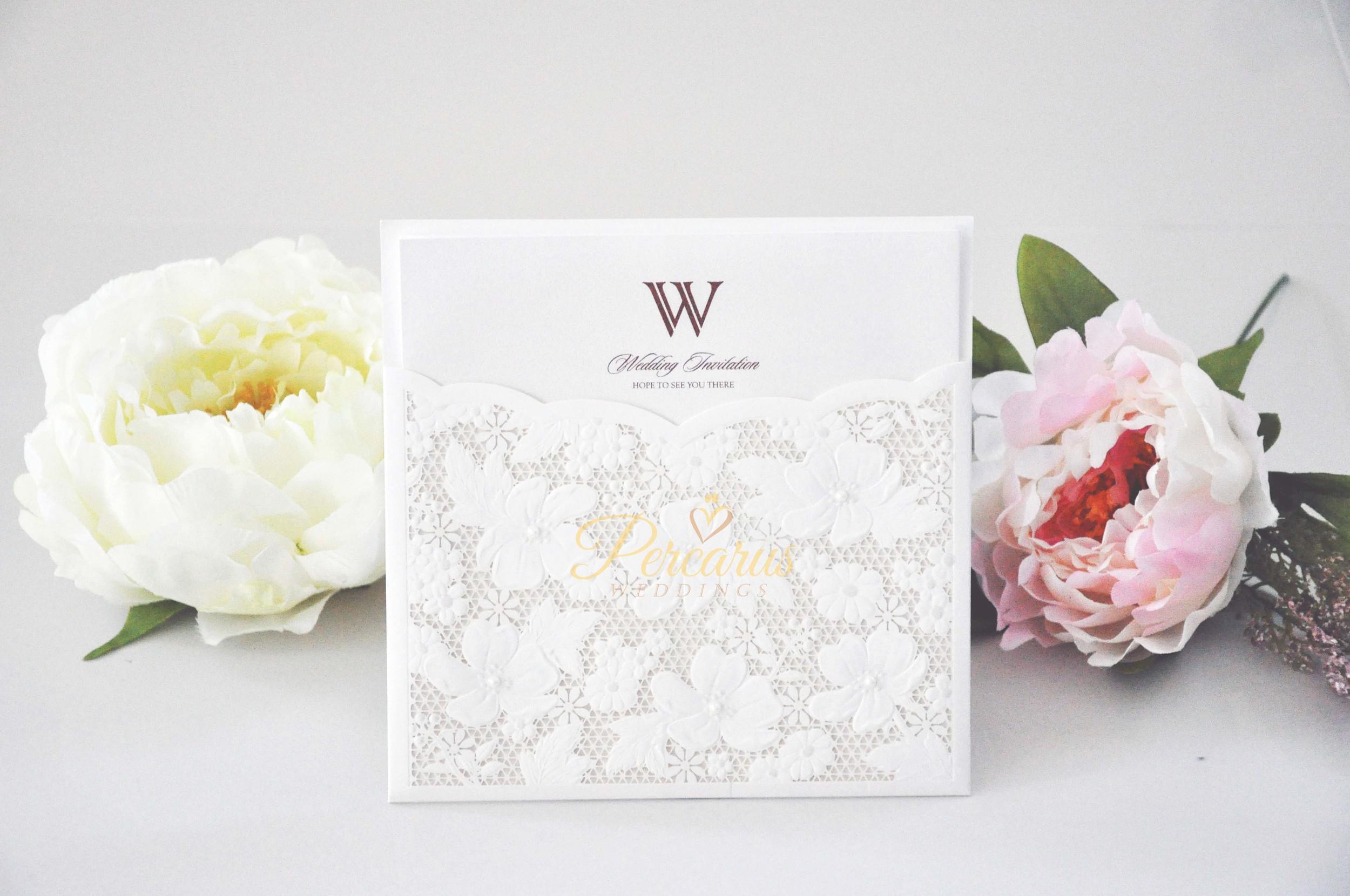 laser-cut-floral-lace-pocket-invitation