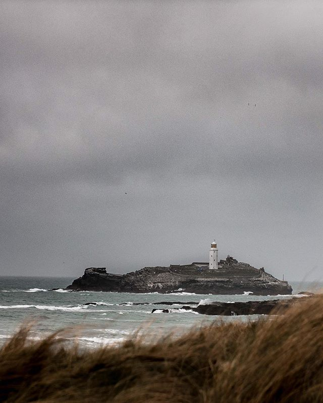 Godrevy Lighthouse. The weather had changed a lot from the bright sunshine we had the day before  #forgeyourowpath #instadaily #natgeo #DOP #nature #outdoors #photography #digitalmarketing #In2nature  #agameoftones #camera #lightroom #filmmaker #filmmaking #uk_shooters #justgoshoot #agameoftones #naturephotography #moodygrams #artofvisuals #instadaily #instagram #videographer #exploremore #theoutbound #outdoortones #effectsadventure