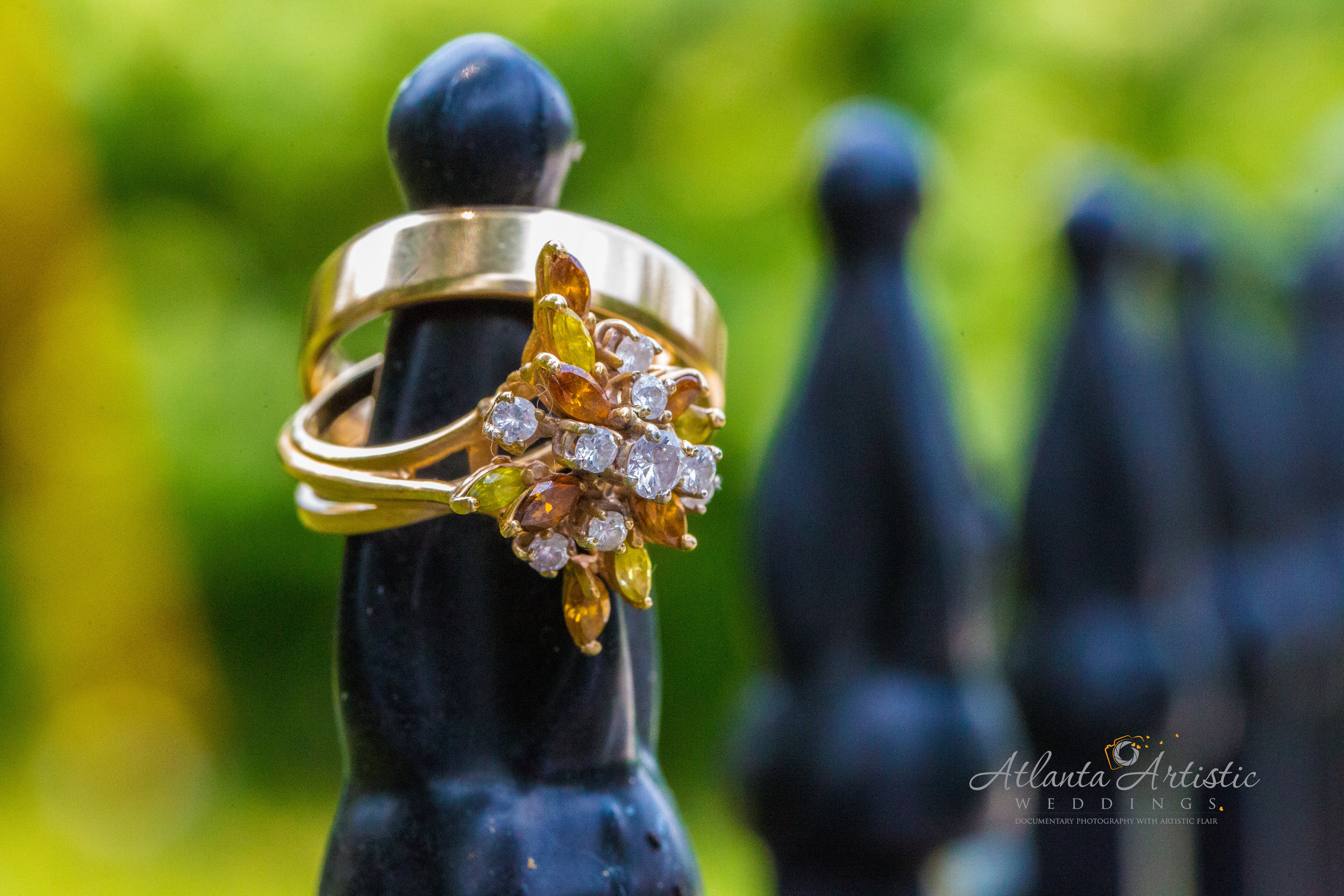 Atlanta Wedding Photographers use Wrought Iron Fence for displaying wedding rings
