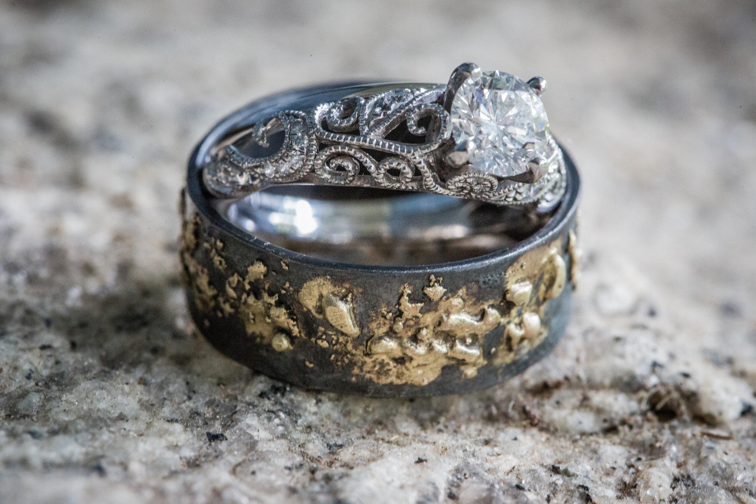 custom designed groom wedding ring  with a  classically designed wedding ring photo by the Atlanta wedding photographers at Atlanta Artistic Weddings