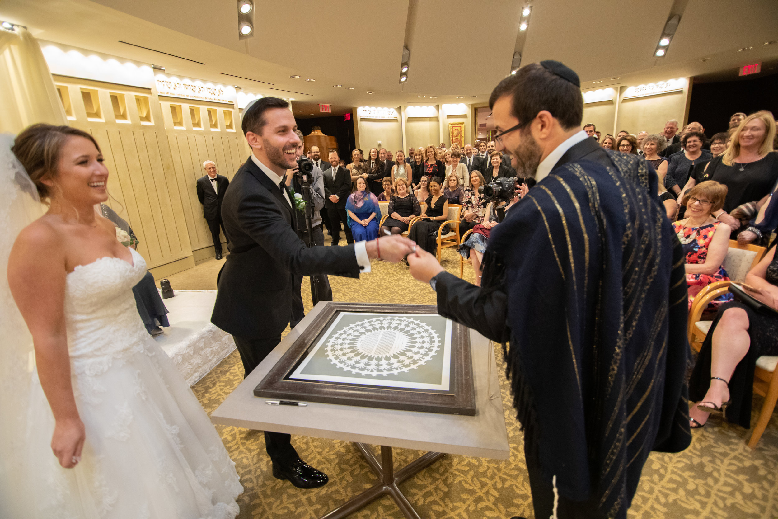Signing of the Ketubah - Photography by the Atlanta Wedding photographers at AtlantaArtisticWeddings