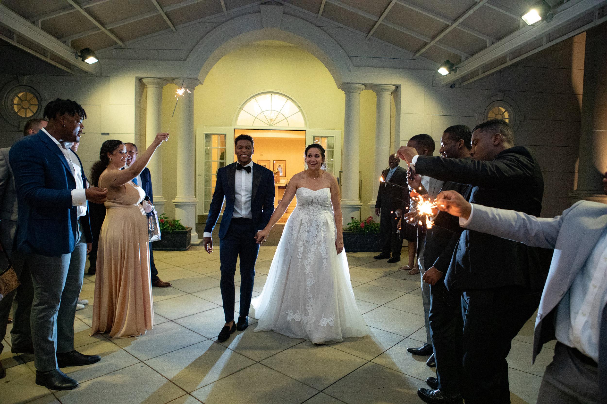 Sparkler exit photo by the Atlanta wedding photographers at AtlantaArtisticWeddings