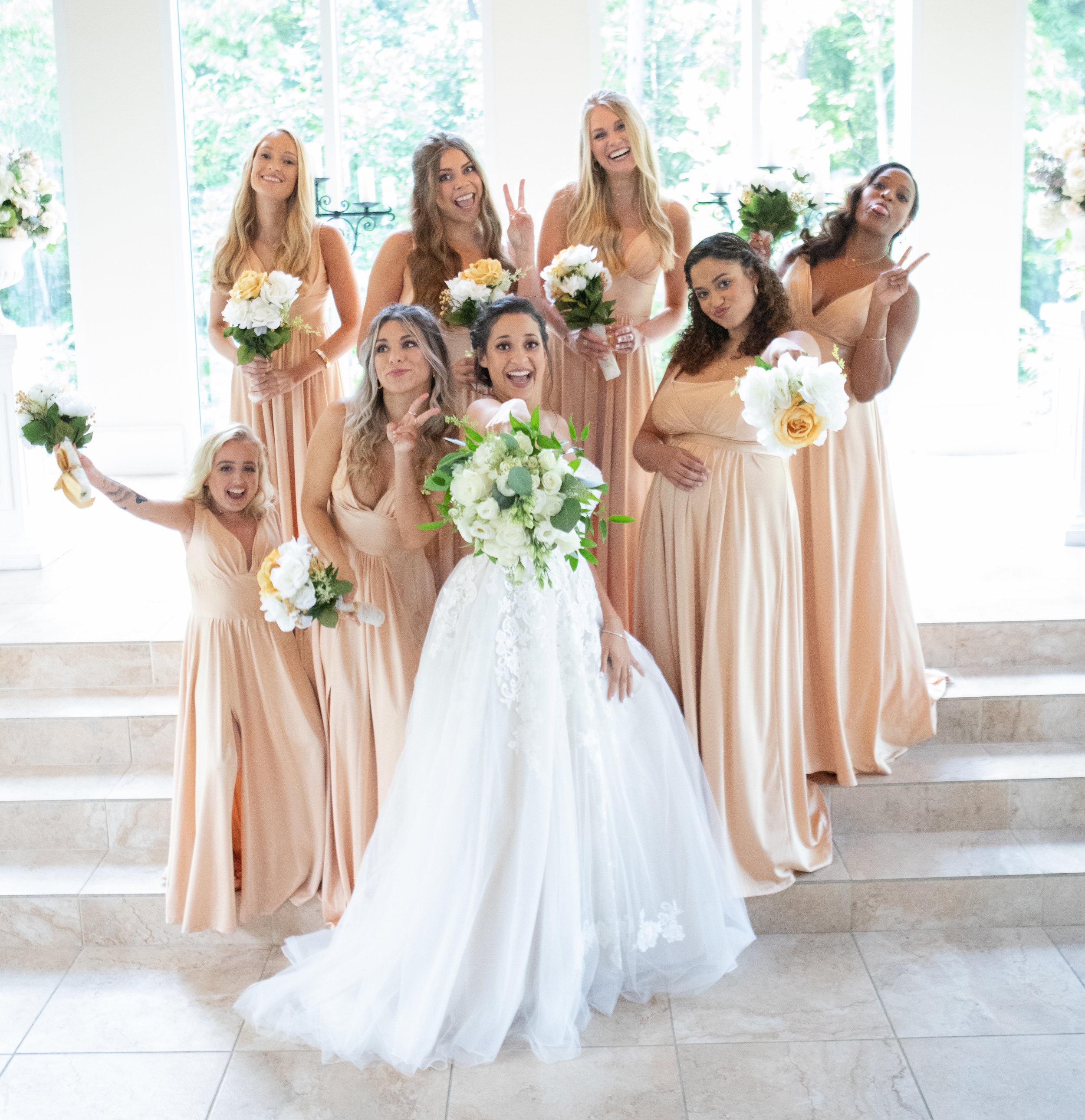 Bride with her bridesmaids photo by the Atlanta wedding photographers at AtlantaArtisticWeddings