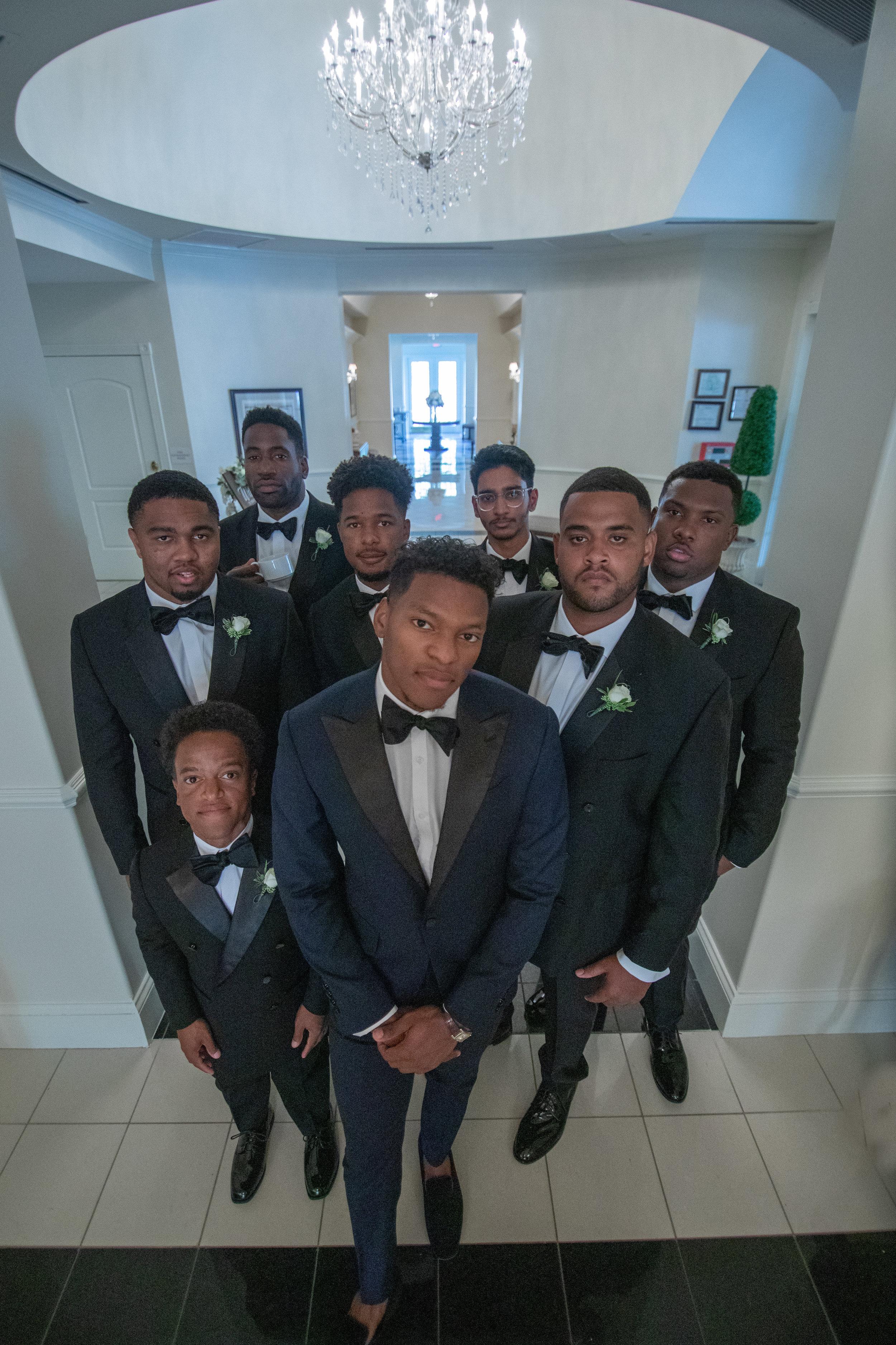 Groom with his groomsmen photo by the Atlanta wedding photographers at AtlantaArtisticWeddings