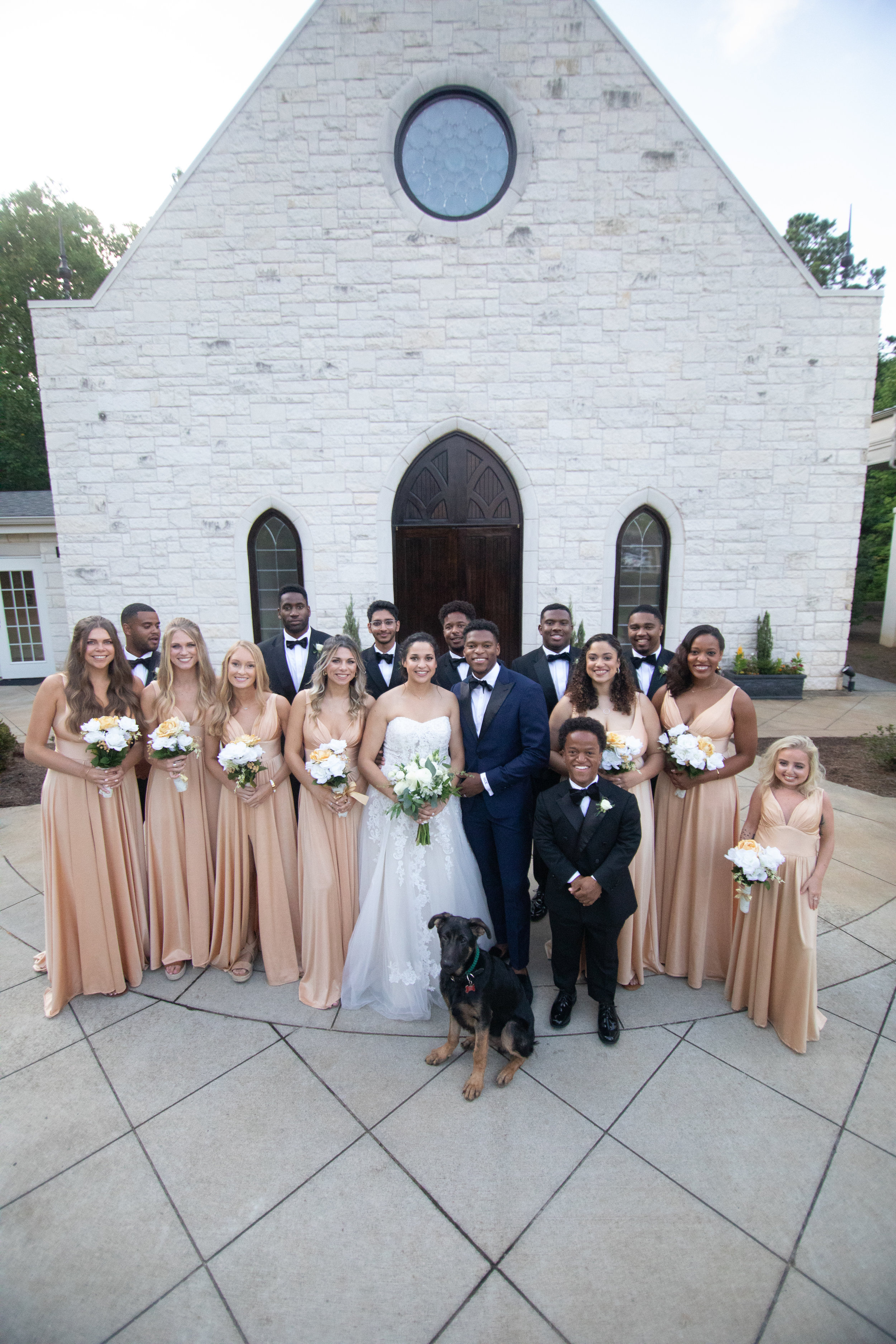 Wedding party with the family dog!  by the Atlanta wedding photographers at AtlantaArtisticWeddings