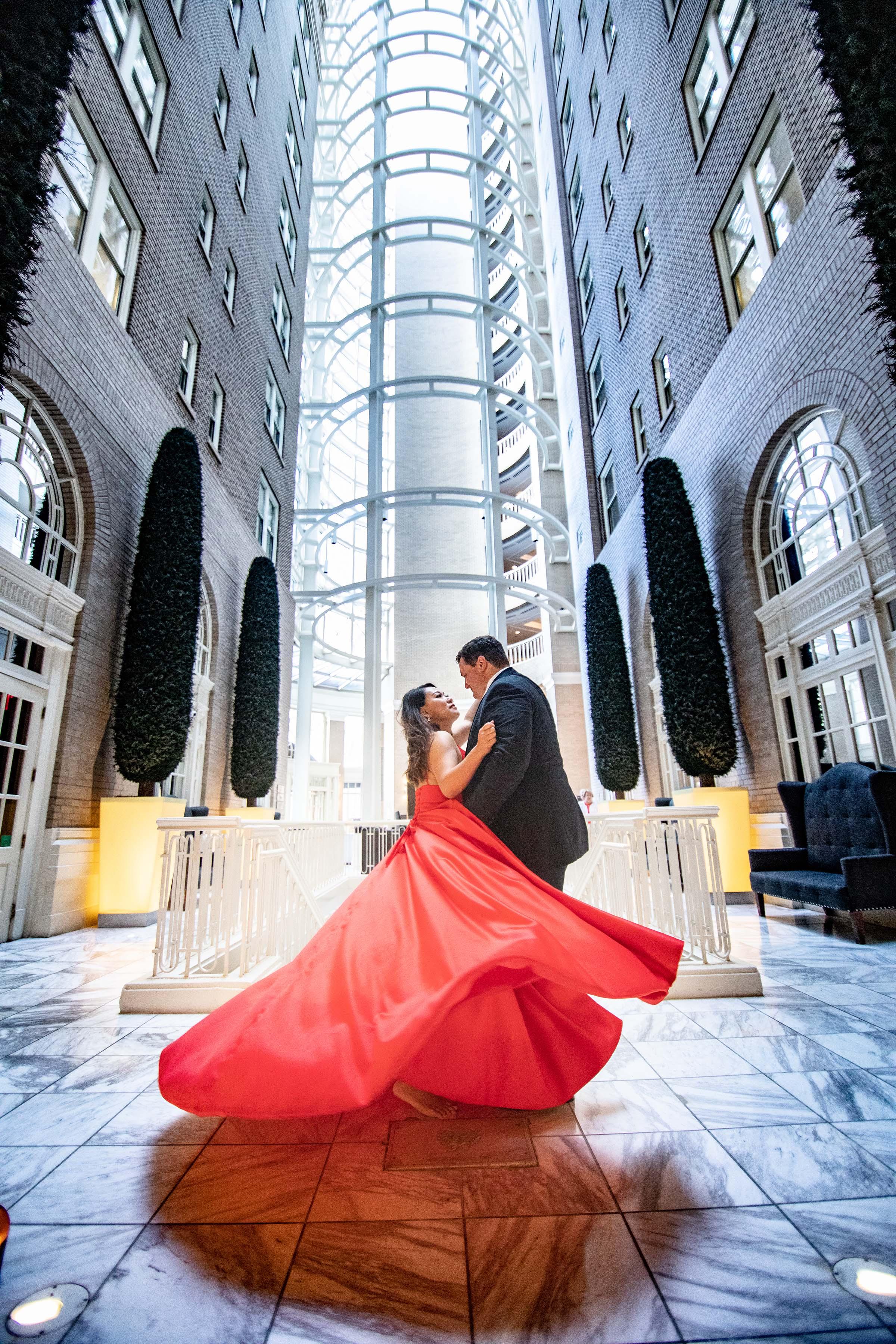 The Historic and elegant Georgian Terrace Atrium located at the corner of Ponce de Leon and Peachtree Street captured by the Atlanta wedding photographers at ww.AtlantaAritsicWeddings.com