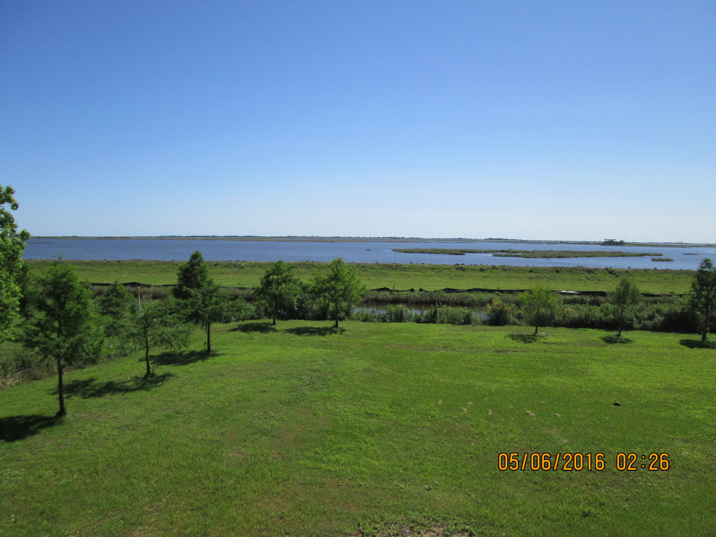 Gulf of Mexico intrudes behind Pointe au Chien Indian Tribal headquarters building.
