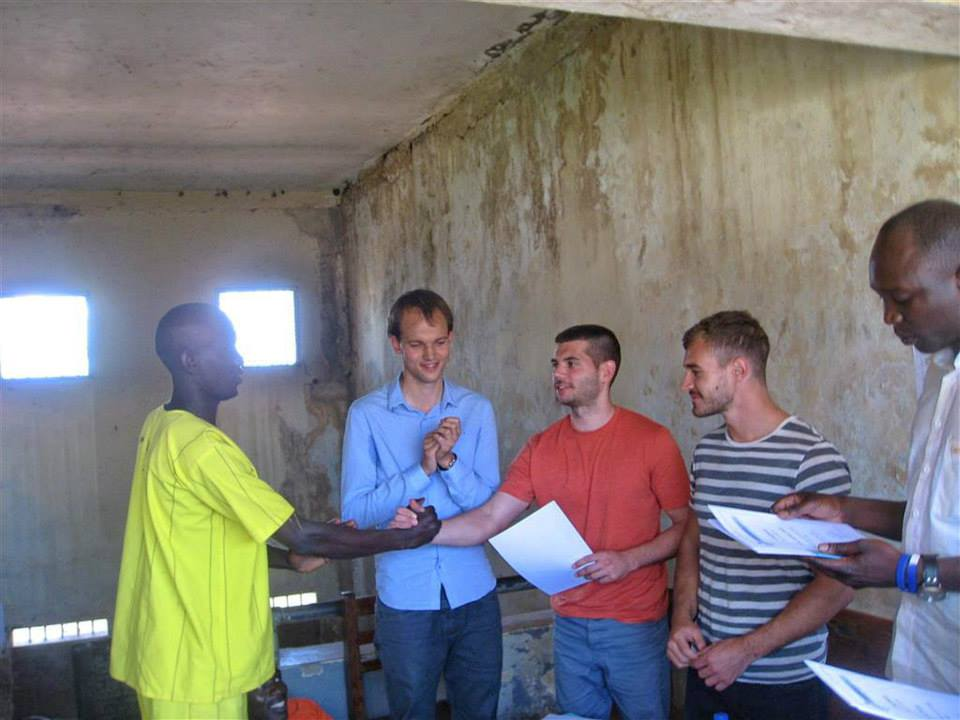 Mike meeting an inmate in a Ugandan prison with Product of Prison