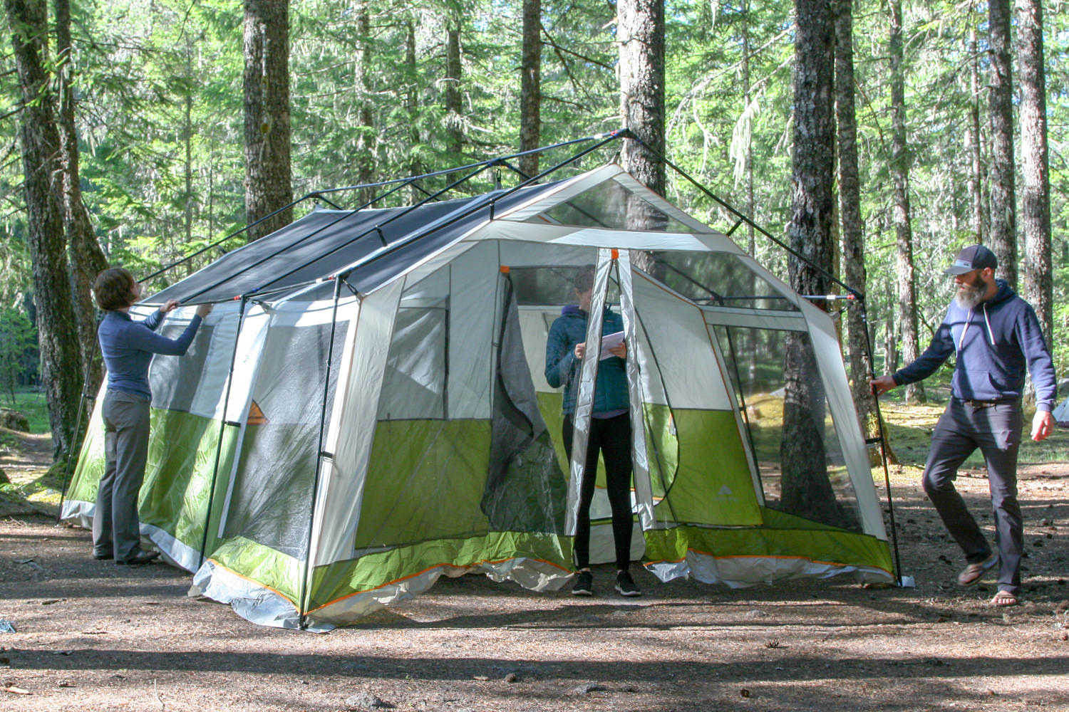 The  Ozark Trail 8-Person Family Cabin's  setup is more complicated and multiple people are needed
