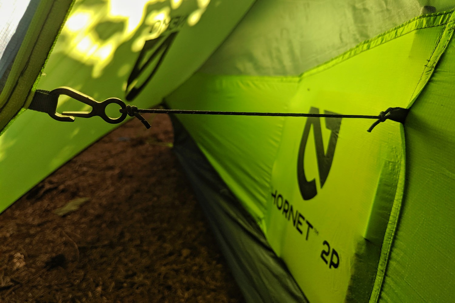 a clip attaching the tent walls to th rainfly provide more space by preventing the walls from sagging when pockets are full.