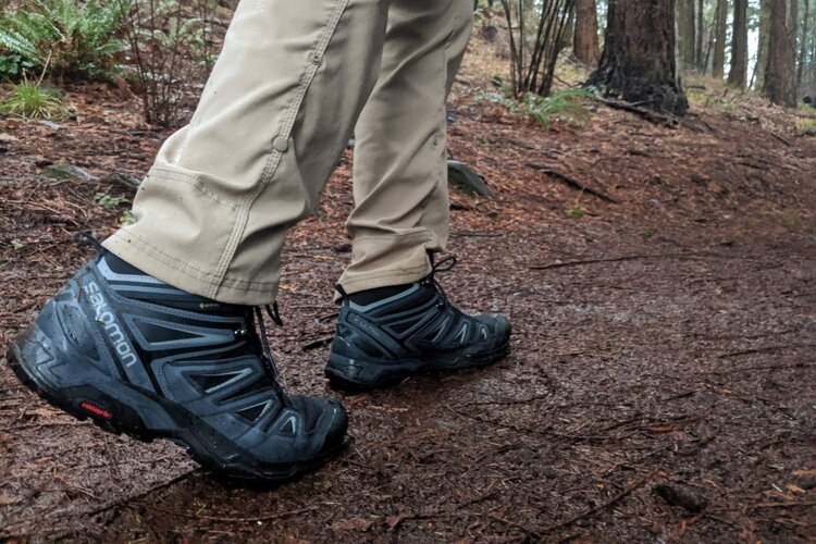Wearing one of our top pick boots, the  Salomon X Ultra 3 Mid GTX , during a soggy day hike