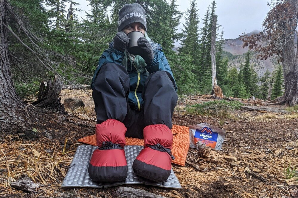 The Feathered Friends Down Booties are a comfy reprieve from your boots while in camp & they can be worn in your sleeping bag to boost warmth.