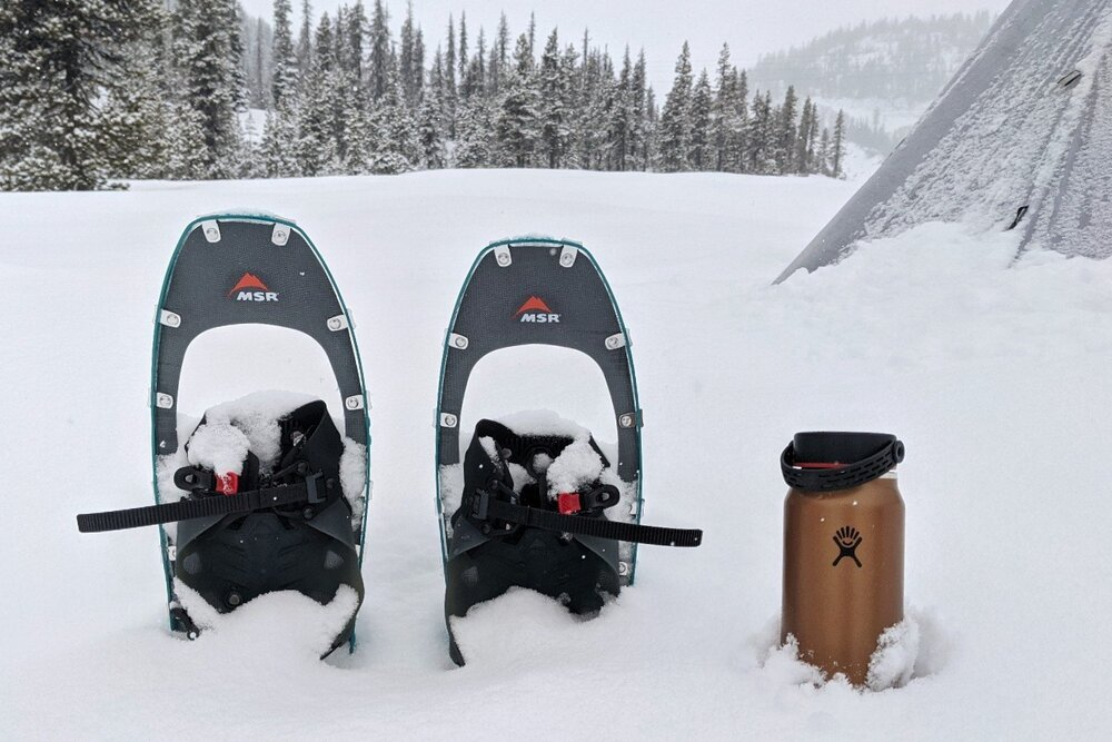 An insulated water bottle, like the Lightweight Hydroflask is a luxury item you won't want to live without on winter camping trips.