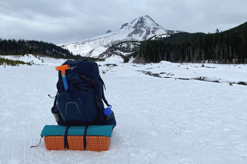 The Osprey Atmos Backpack has plenty of support and capacity for a load of winter camping gear.