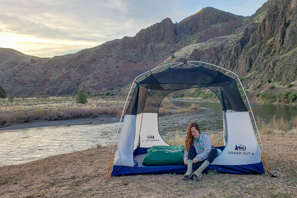 The  REI Grand Hut 4  is one of our favorite camping tents because it's easy to set up, tall enough to stand in, and hold up well to bad weather
