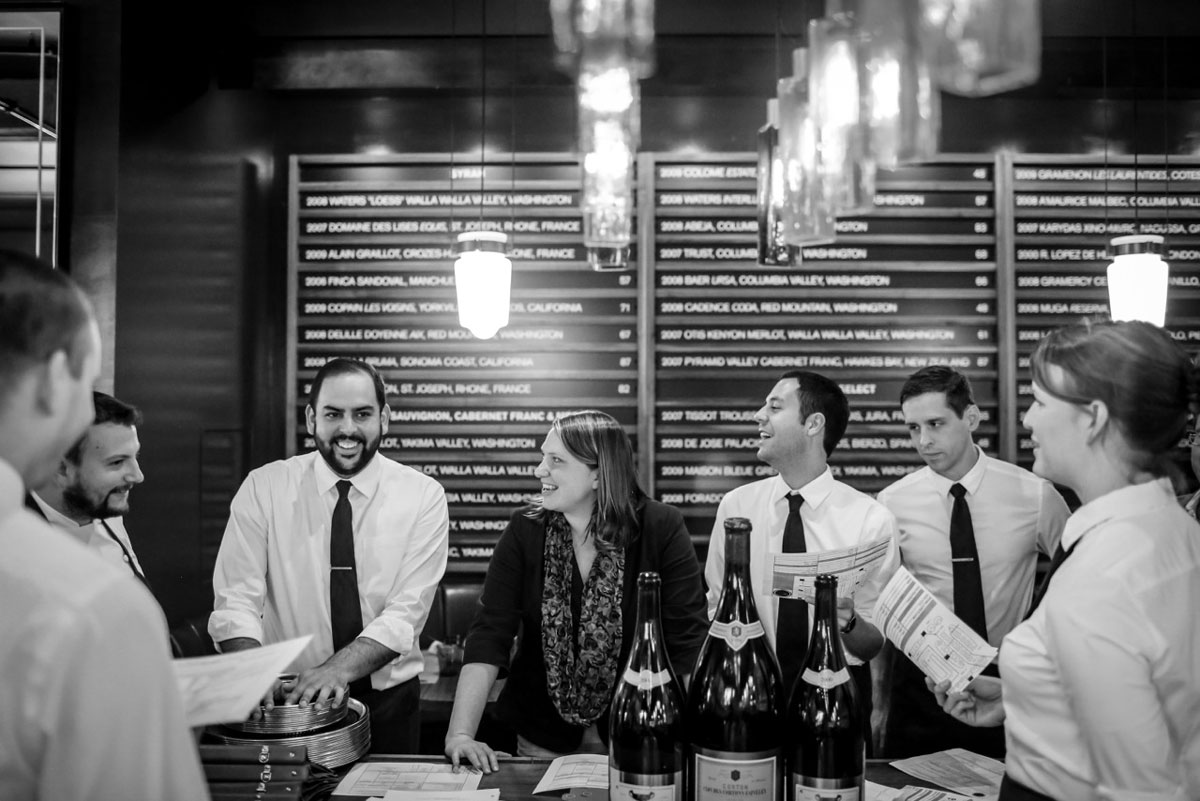 Executive Chef David Varley (far left) shares a laugh with his FOH staff during their pre-service meeting (RN74, Seattle, WA).