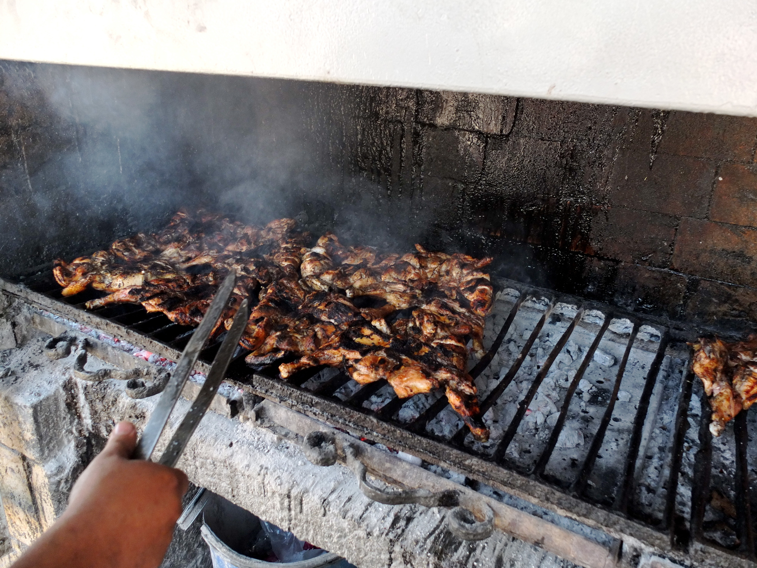 I'm not really sure what the secret to Qa'abar's chicken is, but I was told that it's     locally sourced and simply seasoned. This is the grill on which it's prepared—of all     the photos in this collection, this is the one I wish I could smell.