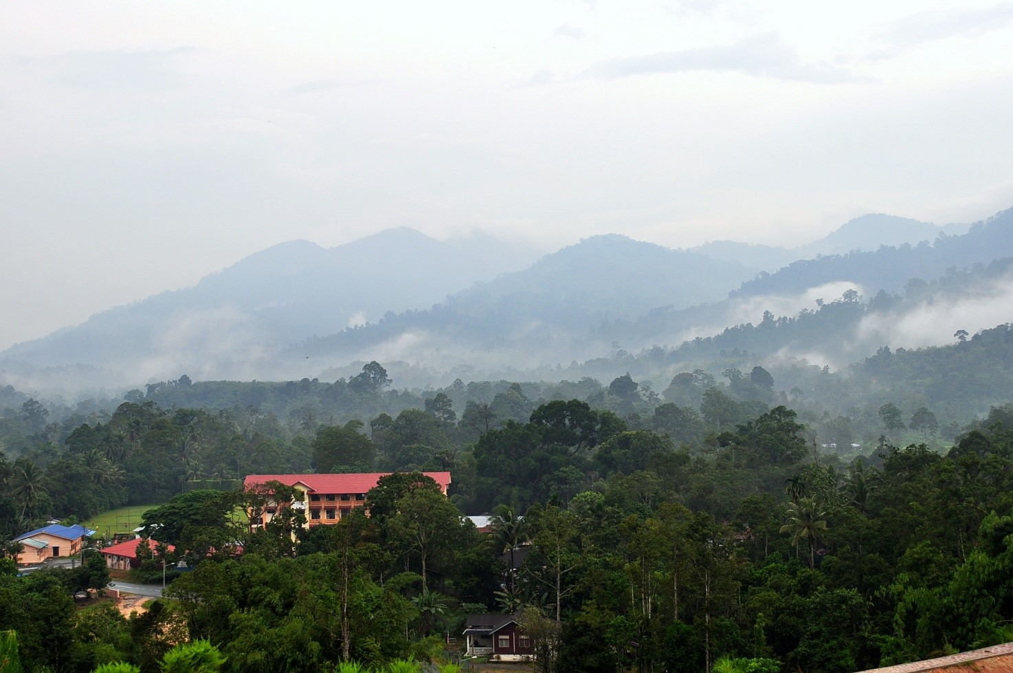 A view of the misty Banjaran Titiwangsa from Janda Baik in the early morning