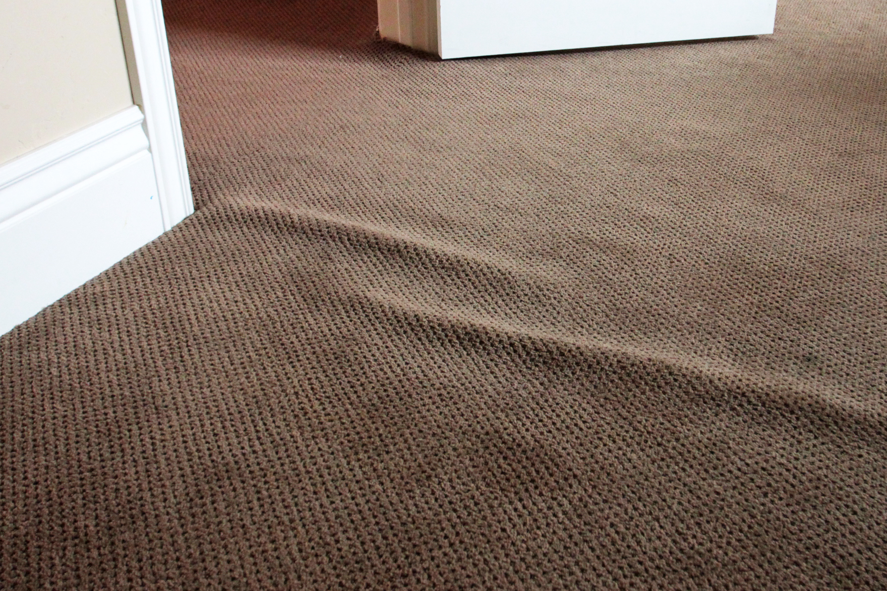 Wrinkled, rippled, loose, bumpy, detached carpet?   We can fix it!