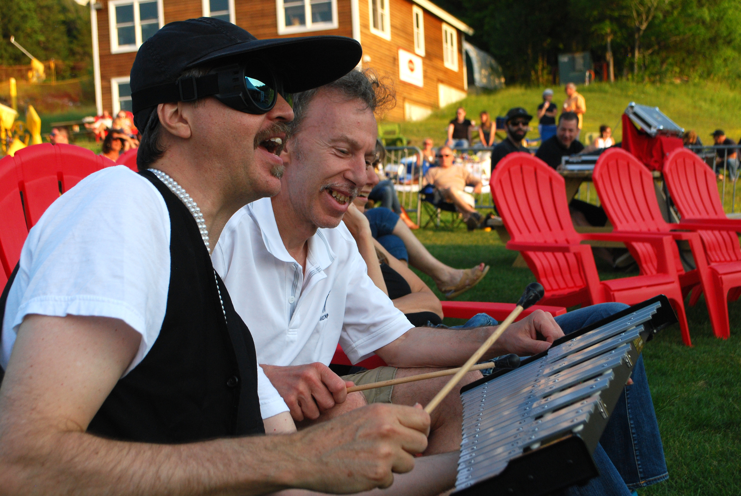 The Right Reverend Dean Dawg rocks out on the glockenspiel with a fan from the crowd!