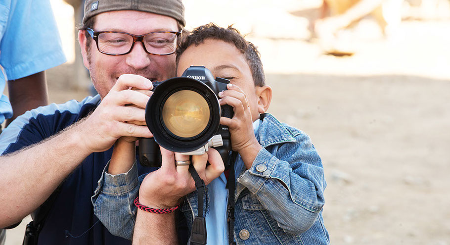 Cecaini'syoungest photographer! This little guy blew me awayhe did not want to see his picture he wanted to take the picture!