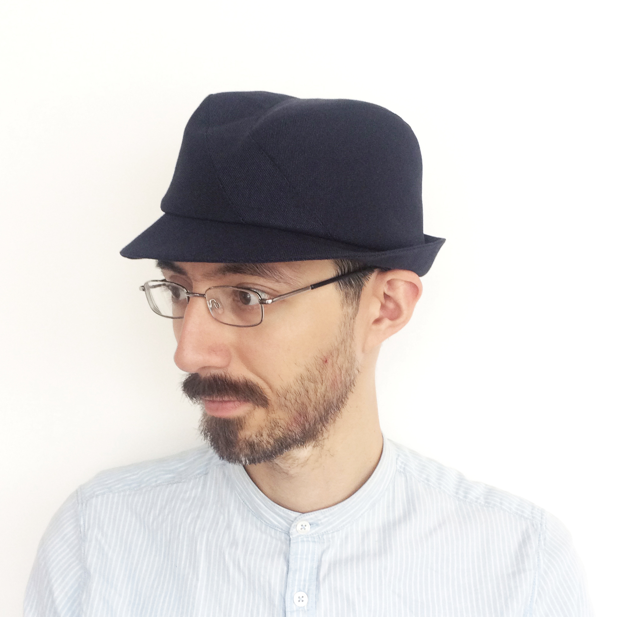 Theo wears 'Berwick' trilby hat in navy Irish linen   buy online