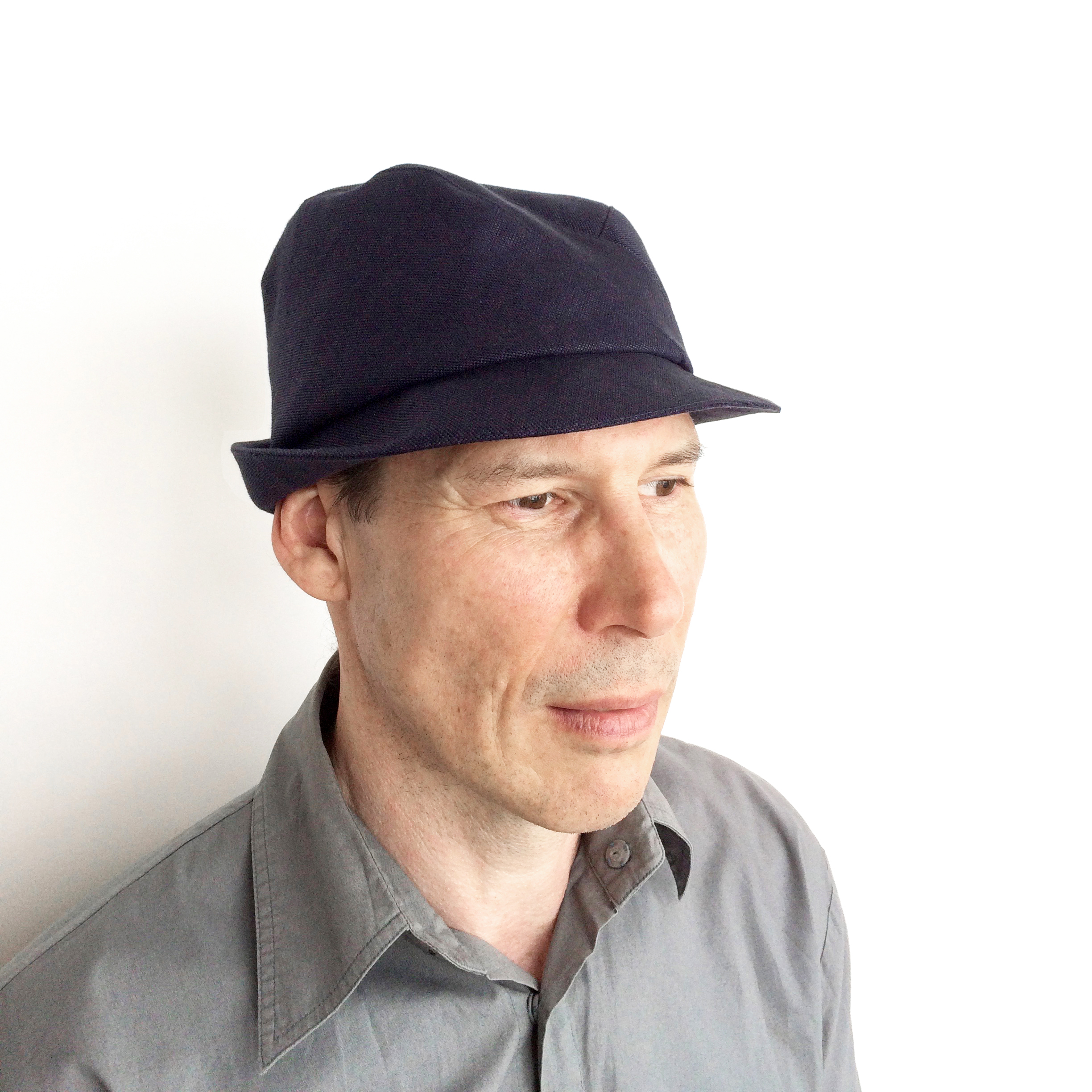 Adrian wears 'Berwick' trilby hat in navy Irish linen   buy online