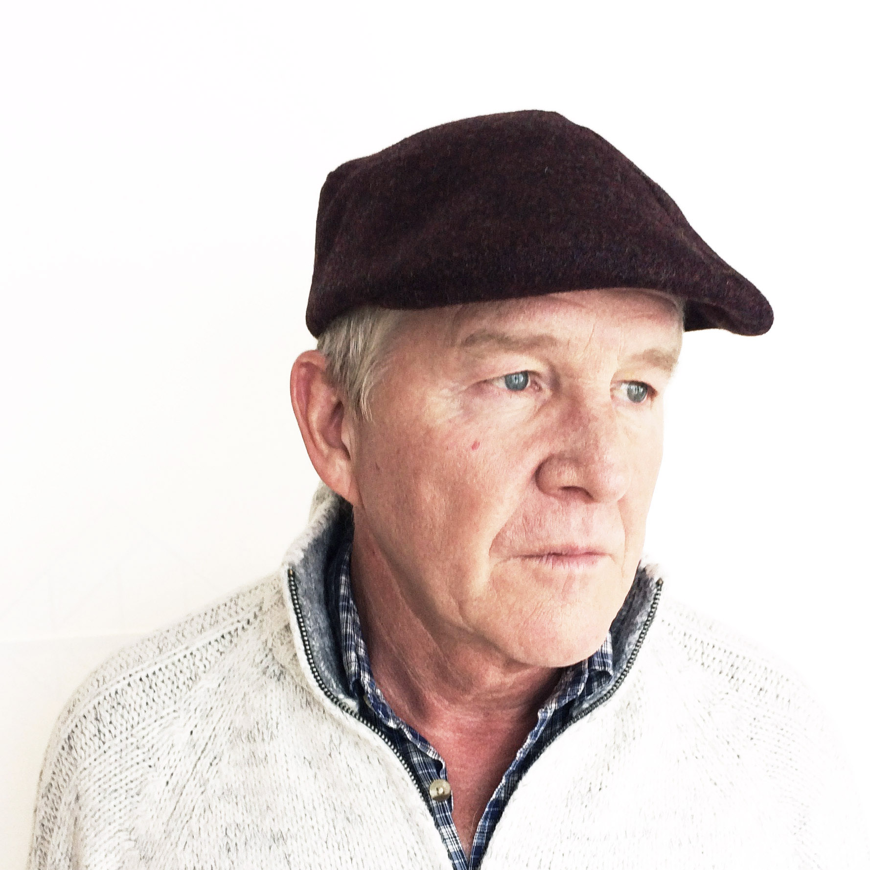Eric wears 'Garvey' flat cap in burgundy wool tweed   enquire  about this hat