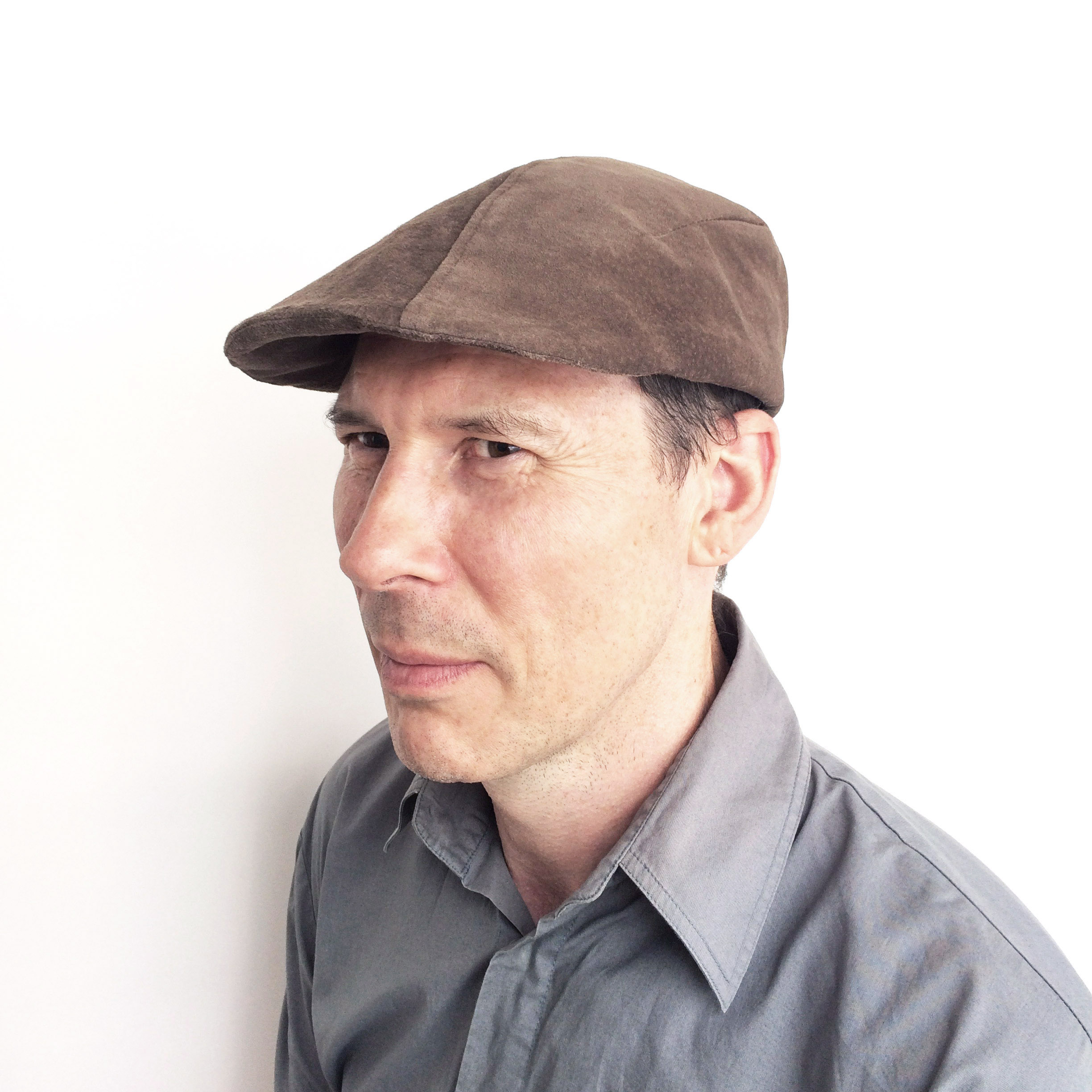 Adrian wears 'Garvey' flat cap in suede   buy online