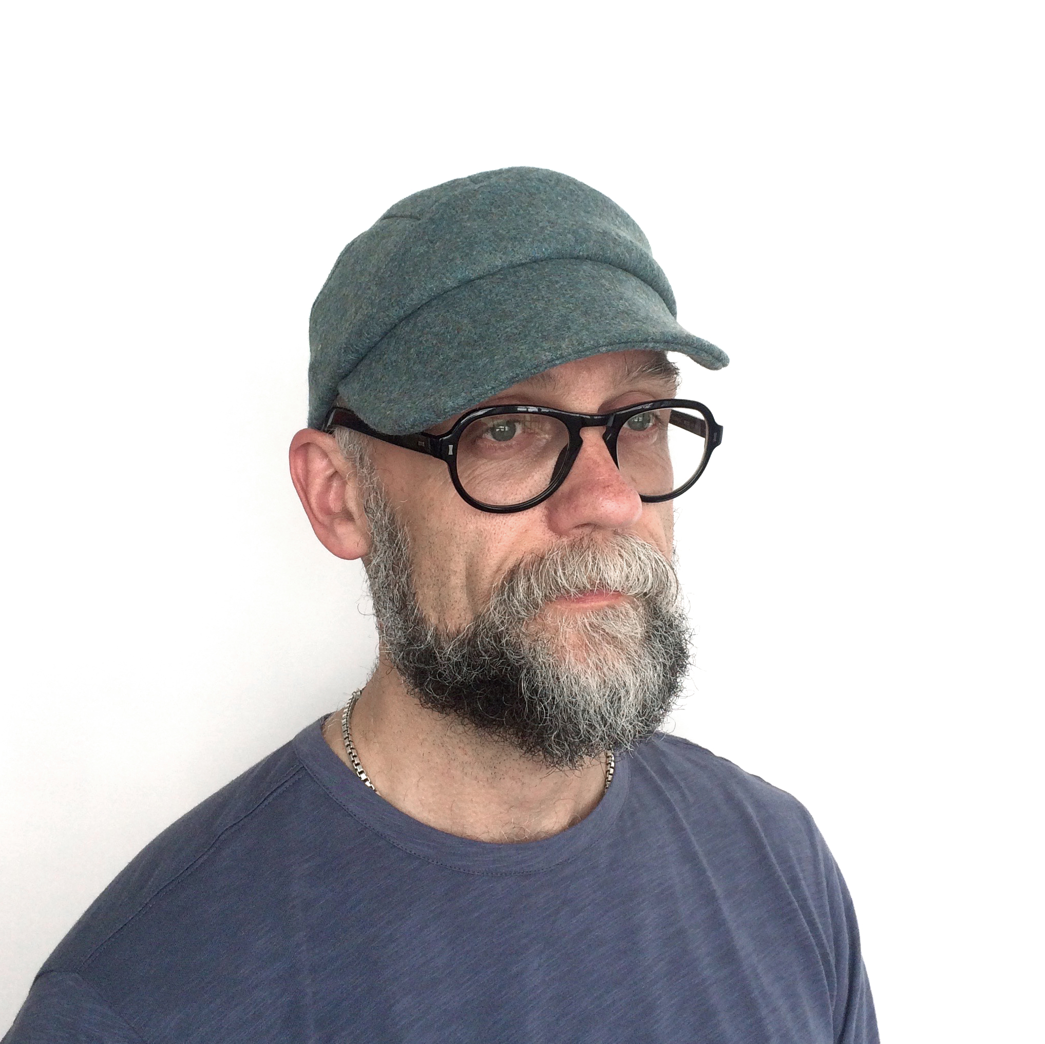 James wears 'Lewis' peaked cap in seagrass Shetland wool   buy online