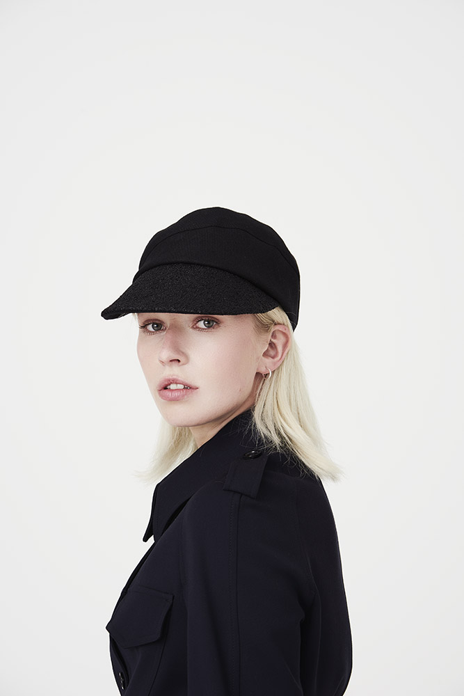 'Petra' peaked cap in black linen with vintage raffia