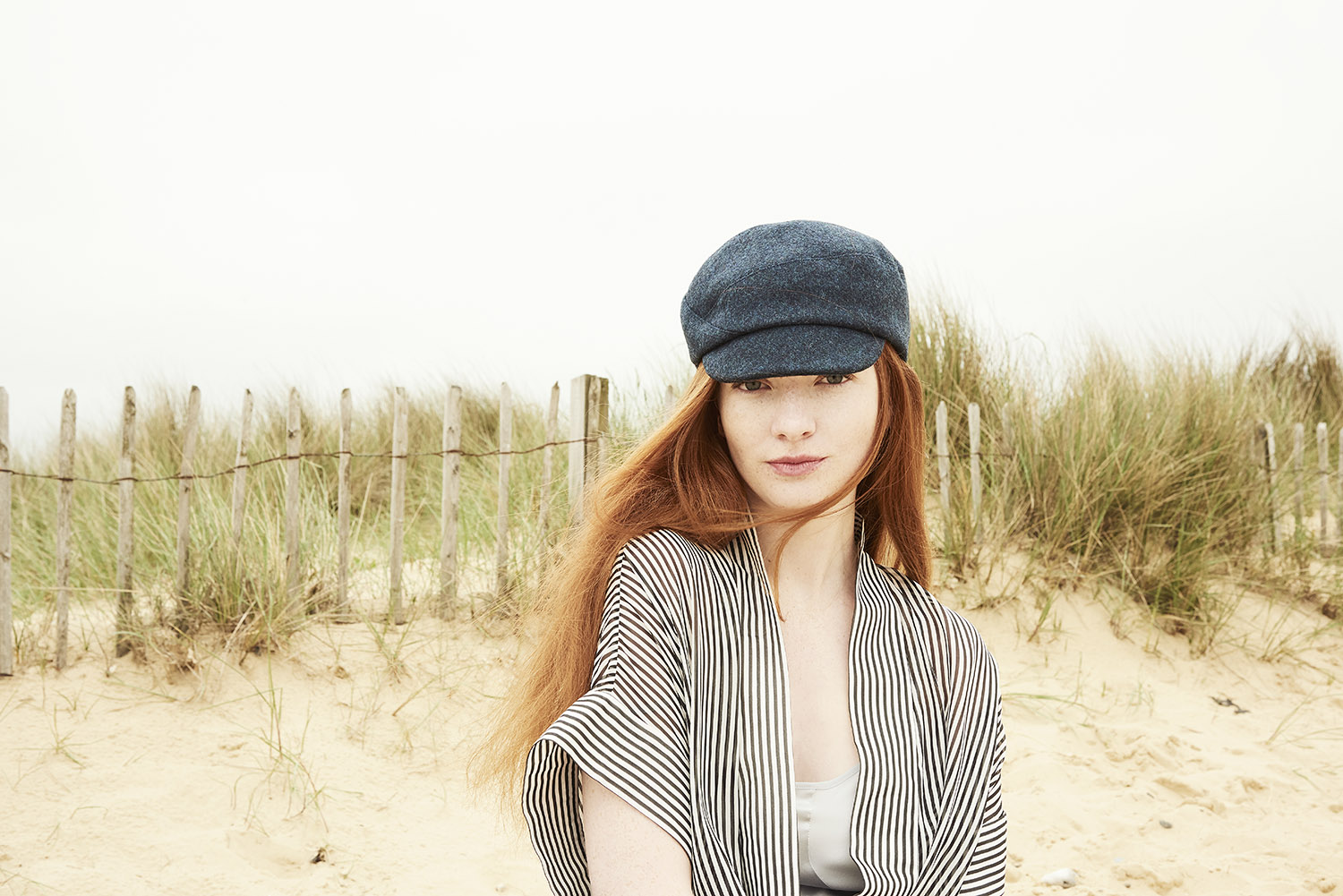Blaize cap for women in a rich teal wool tweed.  See it in the shop .