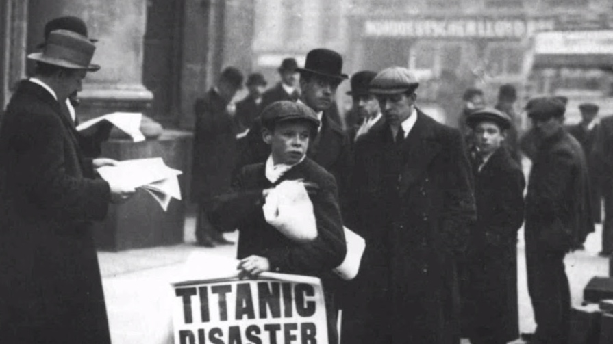 Boy-holding-a-newspaper-with-the-latest-news-about-the-disaster-of-the-Titanic-1912.jpg